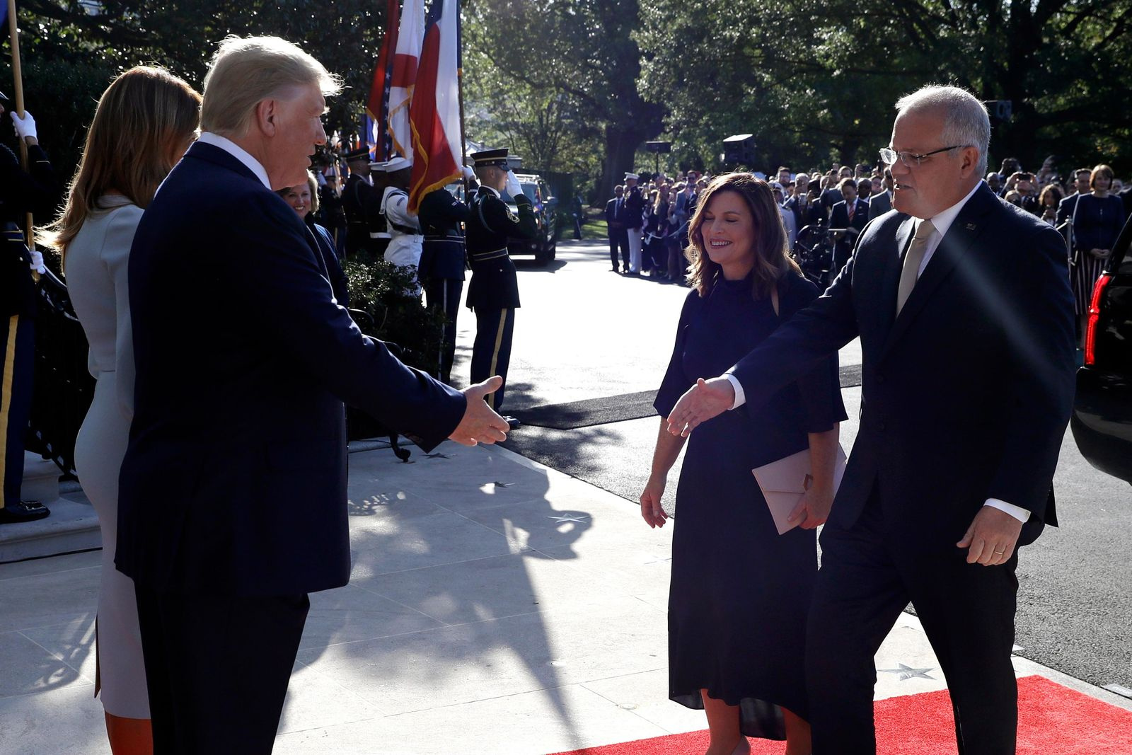 President Donald Trump and first lady Melania Trump welcome Australian Prime Minister Scott Morrison and his wife Jenny Morrison during a State Arrival Ceremony on the South Lawn of the White House, Friday, Sept. 20, 2019, Washington. (AP Photo/Evan Vucci)