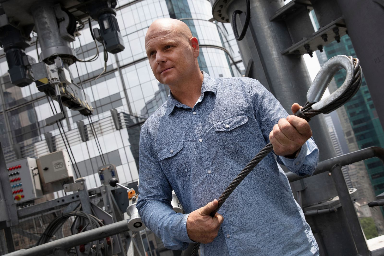 Aerialist Nik Wallenda talks with the media about his planned high-wire act, Thursday, June 20, 2019 in New York. Wallenda and his sister Lijana will cross Times Square on a high wire on Sunday. He is holding a cable similar to the one that will stretch across the square. (AP Photo/Mark Lennihan)
