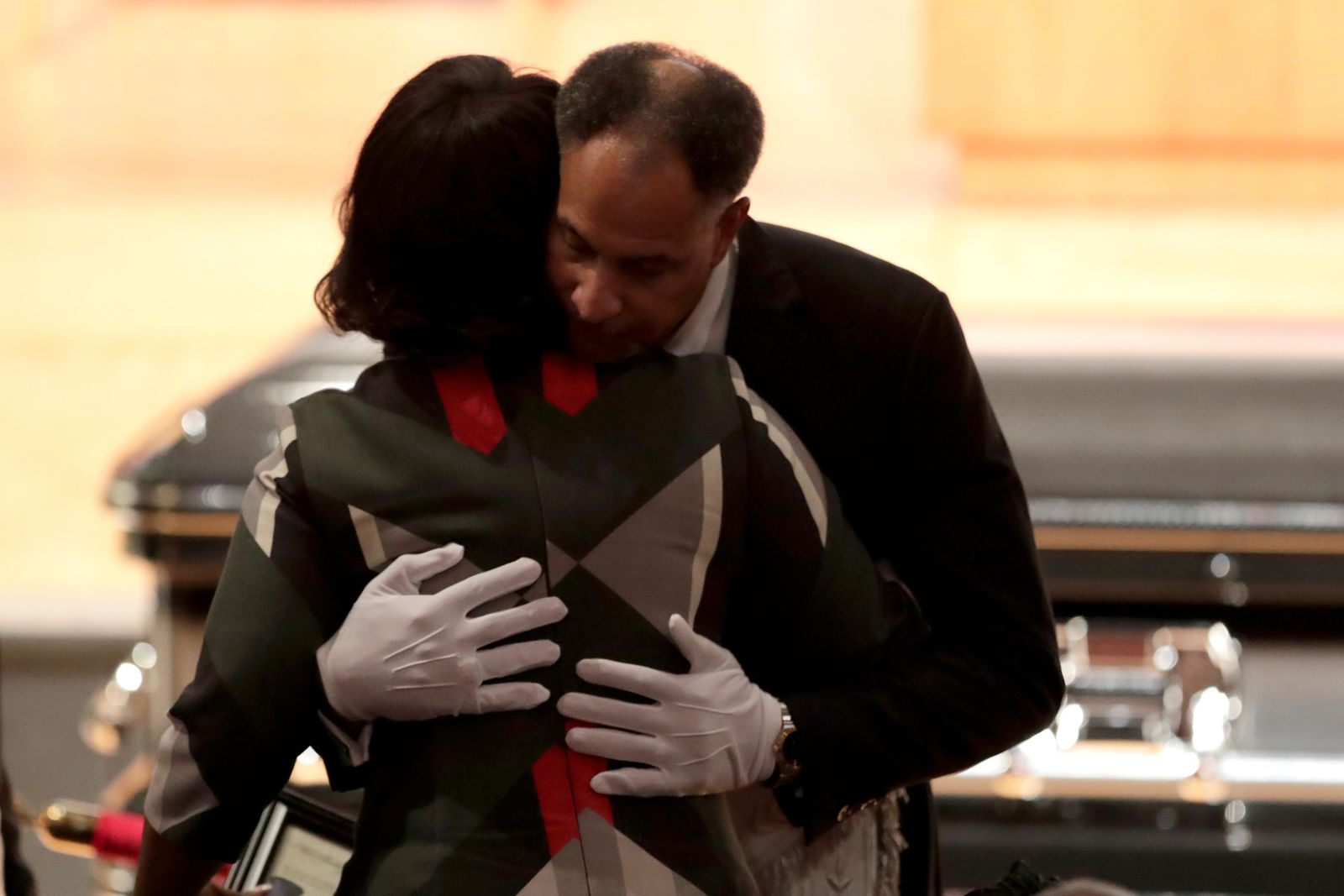 Emmanuel Stanley, grand master of Most Worshipful Prince Hall Grand Lodge of Maryland, right, hugs Maya Rockeymoore, widow of U.S. Rep. Elijah Cummings, during a viewing service at Morgan State University, Wednesday, Oct. 23, 2019, in Baltimore. The Maryland congressman and civil rights champion died Thursday, Oct. 17, at age 68 of complications from long-standing health issues. (AP Photo/Julio Cortez)
