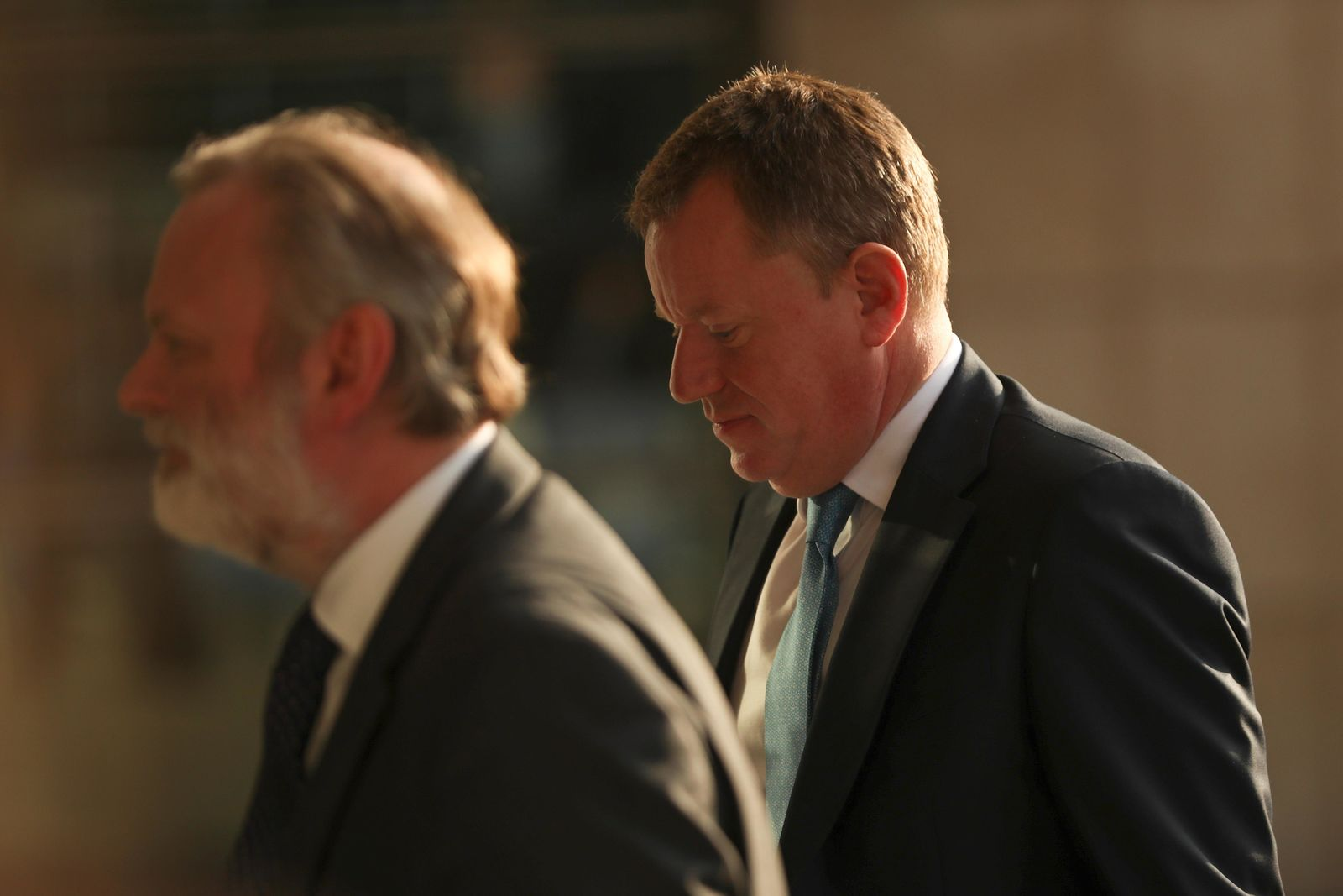 Britain's Brexit advisor David Frost, right, and British Ambassador to the EU Tim Barrow arrive at EU headquarters for a technical meeting on Brexit in Brussels on Monday, Oct. 14, 2019. (AP Photo/Francisco Seco)
