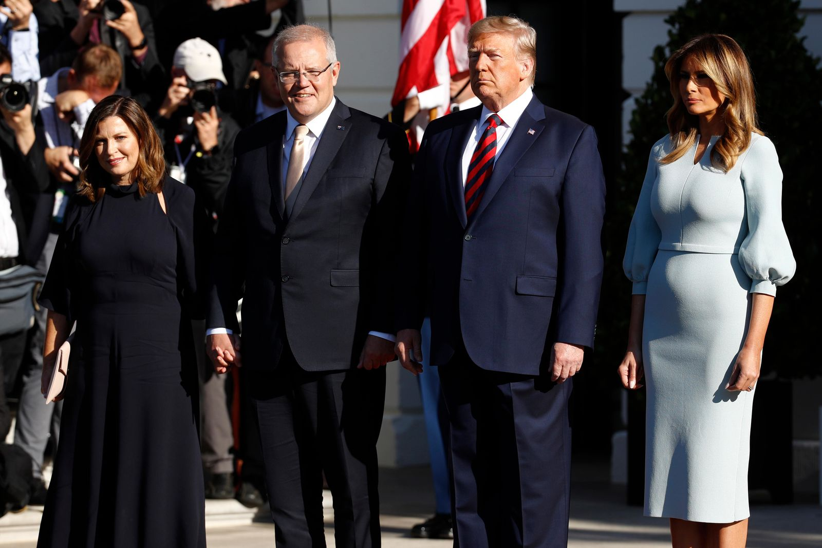 President Donald Trump and first lady Melania Trump welcome Australian Prime Minister Scott Morrison and his wife Jenny Morrison during a State Arrival Ceremony on the South Lawn of the White House in Washington, Friday, Sept. 20, 2019, in Washington. (AP Photo/Patrick Semansky)