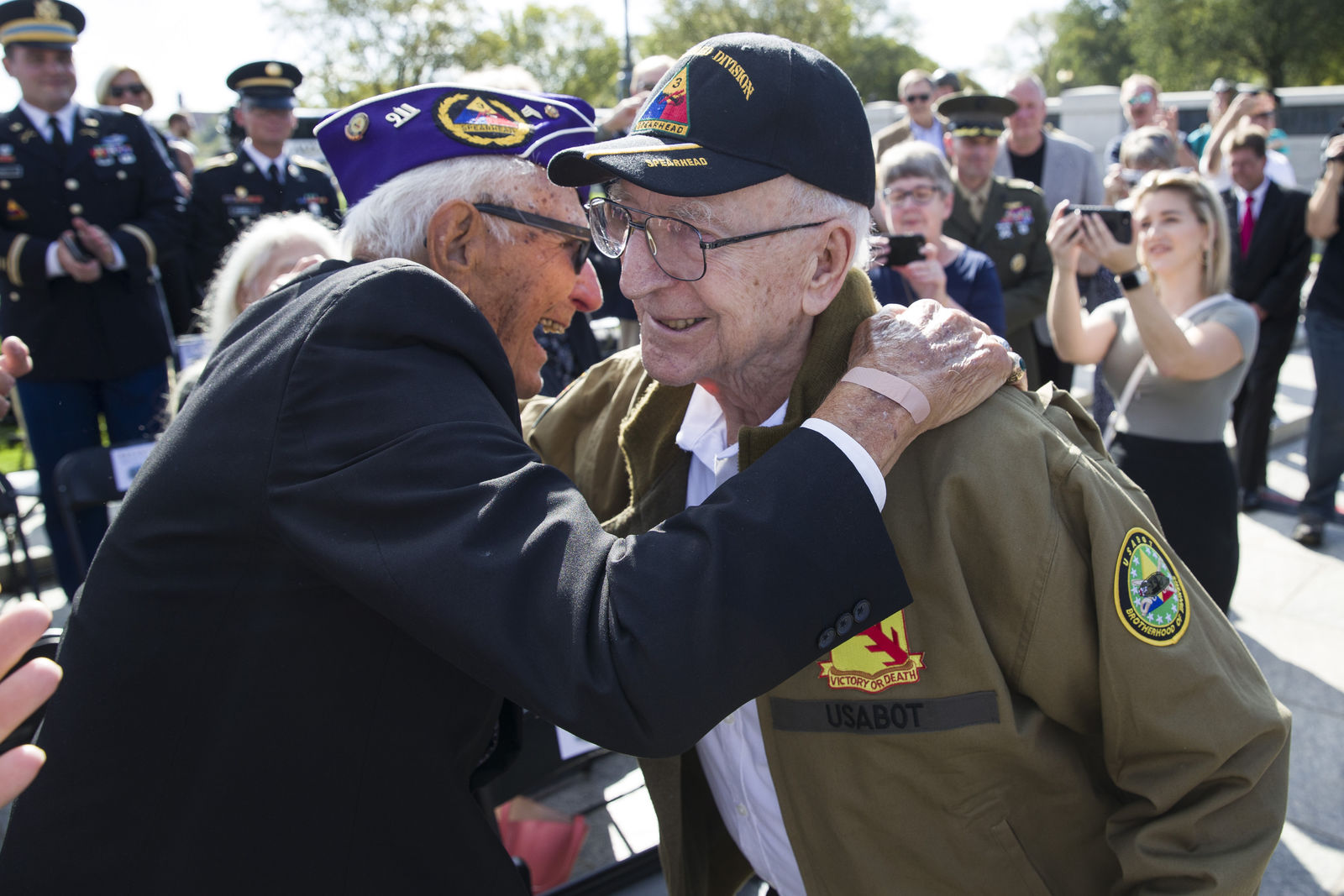 World War II veterans Joseph Caserta, left, and Clarence Smoyer, 96, embrace before a ceremony to present the Bronze Star to Smoyer at the World War II Memorial, Wednesday, Sept. 18, 2019, in Washington.{ } (AP Photo/Alex Brandon)