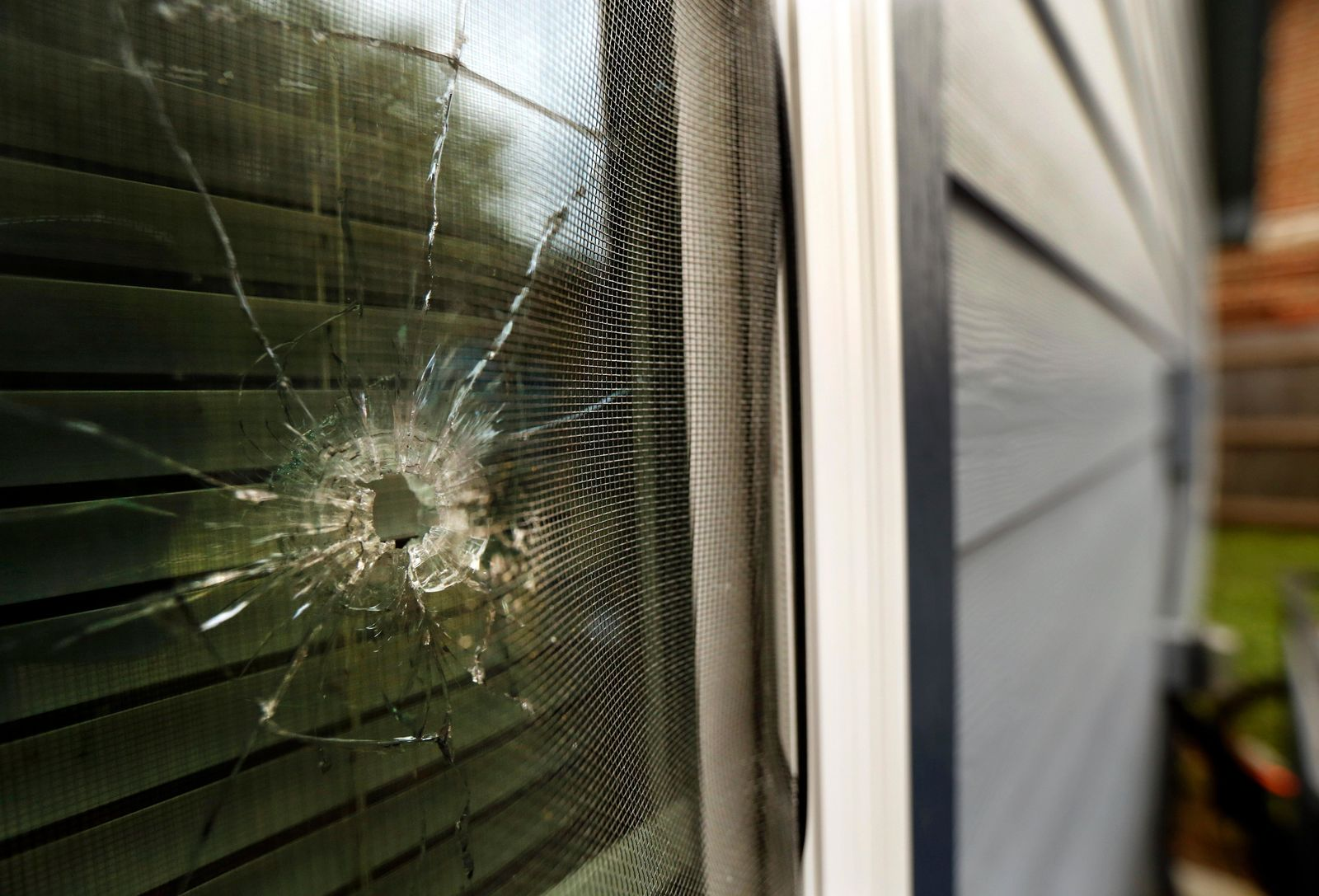 A bullet hole from the police officer's shot is seen in the rear window of Atatiana Jefferson's home on E. Allen Ave in Fort Worth, Texas, Tuesday, Oct. 15, 2019. Jefferson, a black woman, was shot by a white police officer early Saturday, Oct. 12. (Tom Fox/The Dallas Morning News via AP)