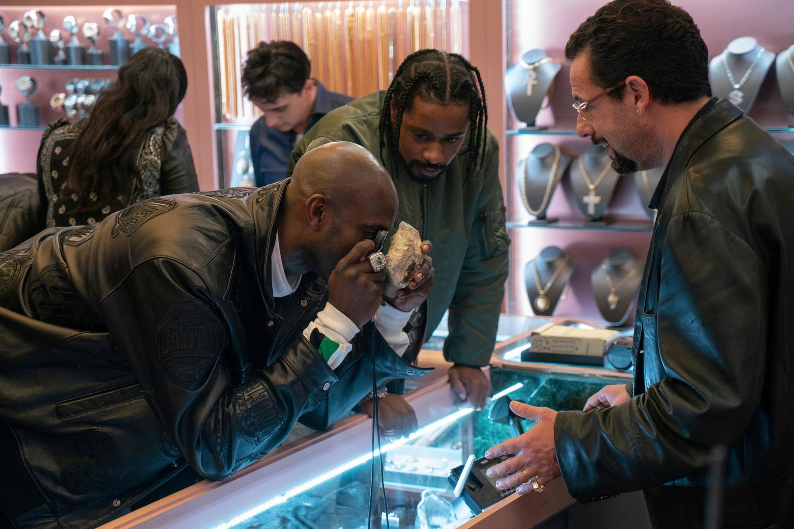 "This image released by A24 shows Kevin Garnett, Lakeith Stanfield and Adam Sandler in a scene from ""Uncut Gems.""  (A24 via AP)"