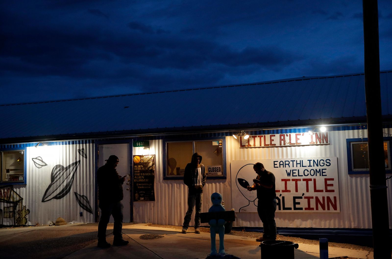 "People stand around the Little A'Le'Inn during an event inspired by the ""Storm Area 51"" internet hoax, Thursday, Sept. 19, 2019, in Rachel, Nev. Hundreds have arrived in the desert after a Facebook post inviting people to ""see them aliens"" got widespread attention and gave rise to festivals this week. (AP Photo/John Locher)"