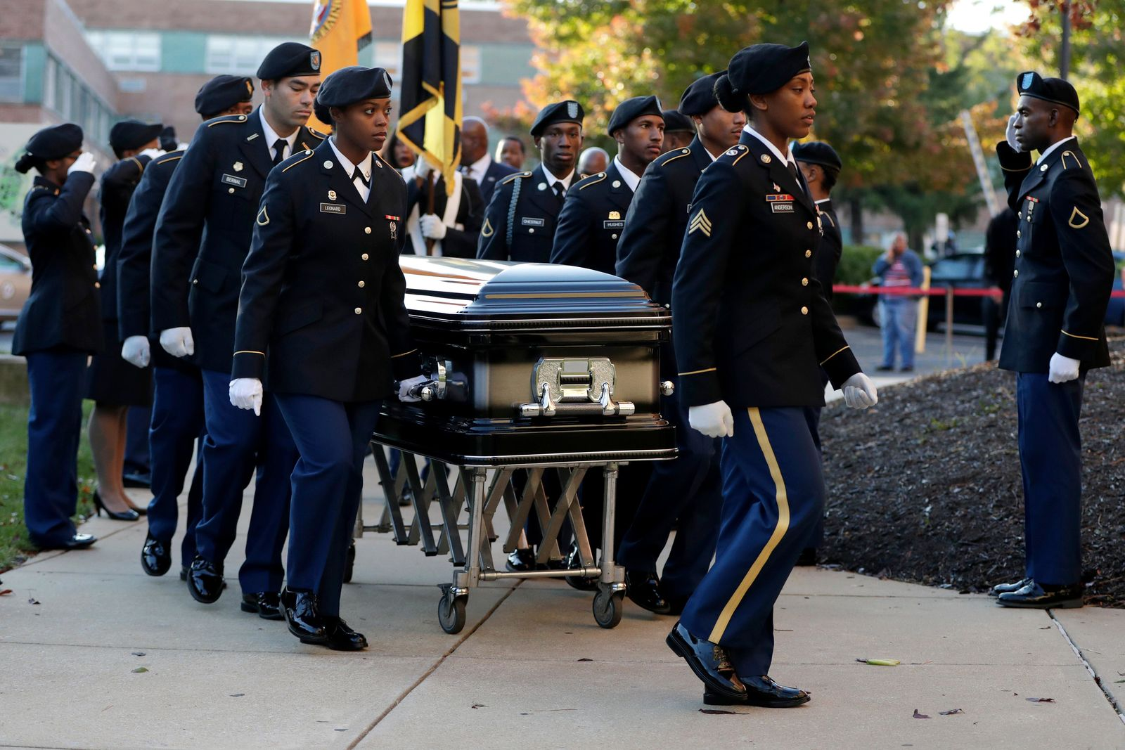 Pallbearers walk with a casket carrying the body of U.S. Rep. Elijah Cummings as it arrives at Morgan State University ahead of a public viewing, Wednesday, Oct. 23, 2019, in Baltimore. (AP Photo/Julio Cortez)