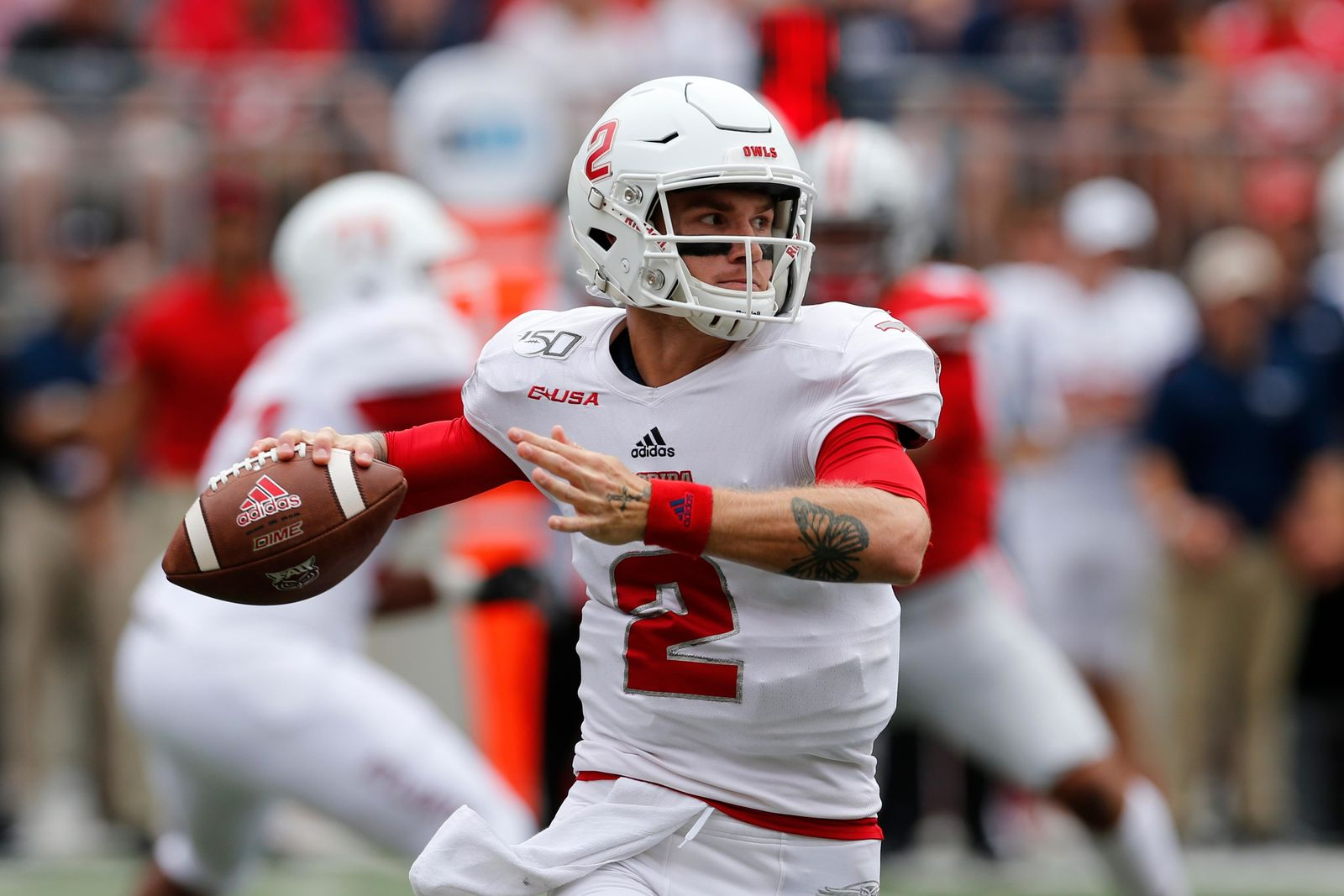 Florida Atlantic quarterback Chris Robison drops back to pass against Ohio State during the first half of an NCAA college football game Saturday, Aug. 31, 2019, in Columbus, Ohio. (AP Photo/Jay LaPrete)