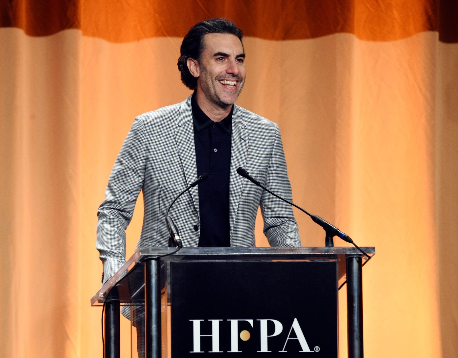 Actor Sacha Baron Cohen addresses the audience at the 2019 Hollywood Foreign Press Association's Annual Grants Banquet at the Beverly Wilshire Hotel, Wednesday, July 31, 2019, in Beverly Hills, Calif. (Photo by Chris Pizzello/Invision/AP)