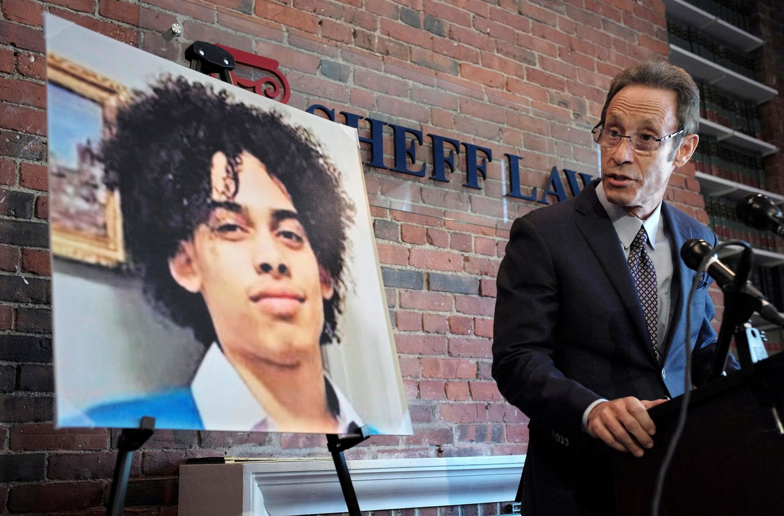 FILE — In this Oct. 25, 2018, file photo, Doug Sheff, right, an attorney for the family of Leonel Rondon, pictured at left, speaks during a news conference, in Boston.{ } (AP Photo/Steven Senne, File)