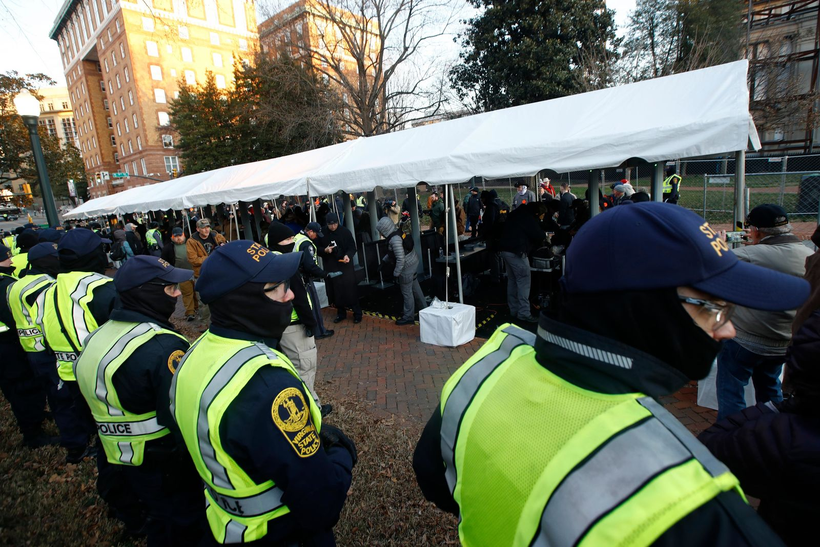Virginia State police troopers stand near a security checkpoint before demonstrators enter the capitol grounds ahead of a pro gun rally, Monday, Jan. 20, 2020, in Richmond, Va. (AP Photo/Steve Helber)