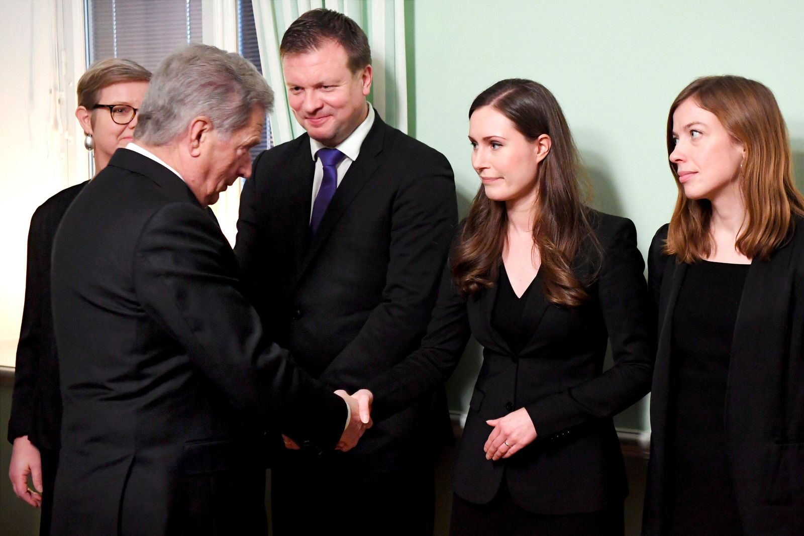 President of Finland Sauli Niinisto, left, greets the new Prime Minister of Finland Sanna Marin, center, before a meeting in Helsinki, Finland on Tuesday Dec. 10, 2019. Finland's parliament chose Sanna Marin as the country's new prime minister Tuesday, making the 34-year-old the world's youngest sitting head of government. (Jussi Nukari/Lehtikuva via AP)
