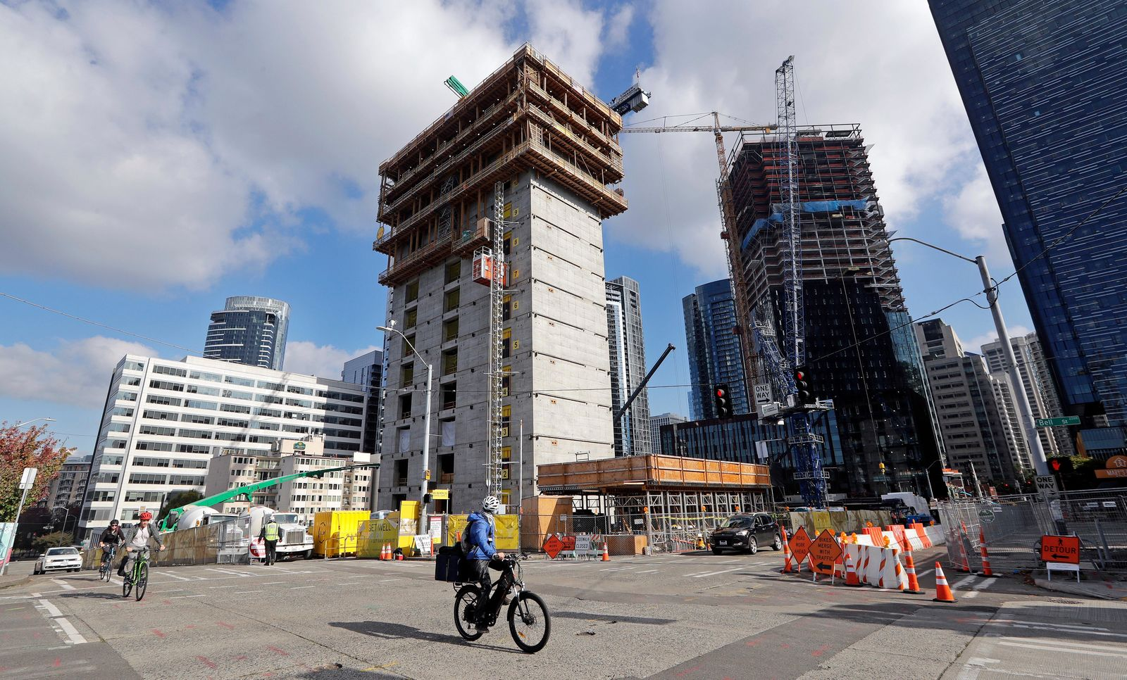 In this photo taken Wednesday, Oct. 10, 2018, construction goes on at the site of a new Amazon building, where space will be provided for a Mary's Place Family Shelter, in downtown Seattle. (AP Photo/Elaine Thompson)