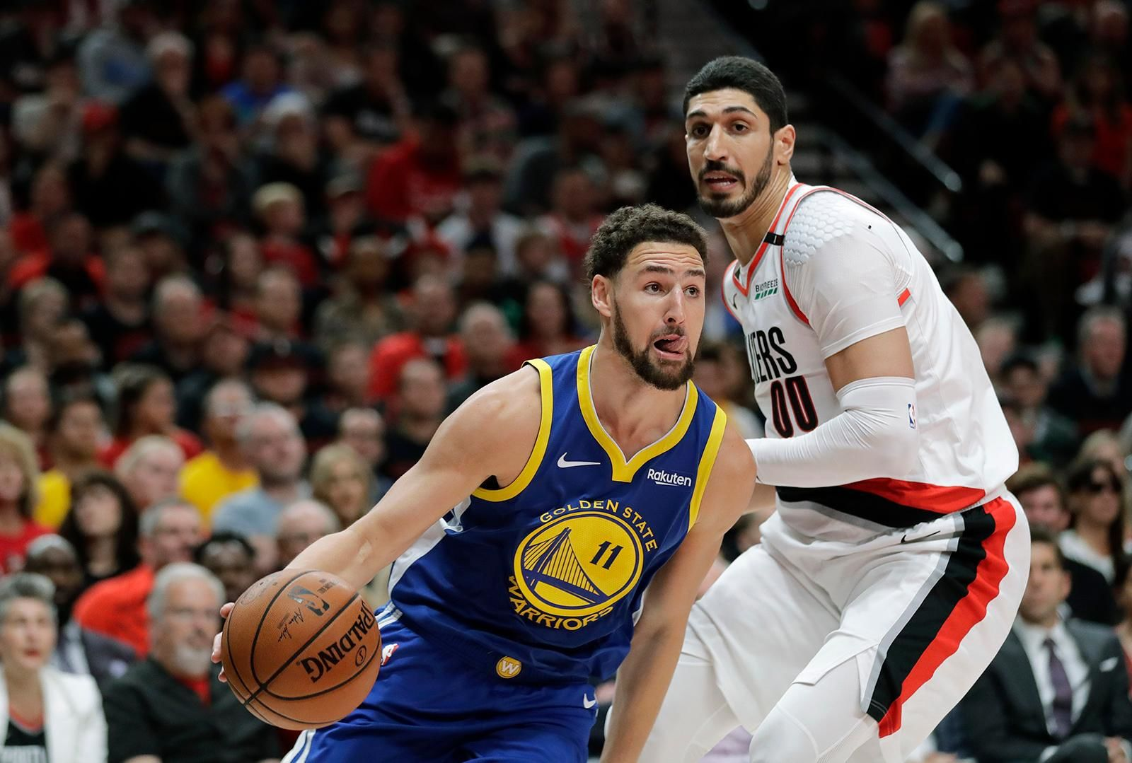 Golden State Warriors guard Klay Thompson (11) drives around Portland Trail Blazers center Enes Kanter, right, during the first half of Game 3 of the NBA basketball playoffs Western Conference finals, Saturday, May 18, 2019, in Portland, Ore. (AP Photo/Ted S. Warren)
