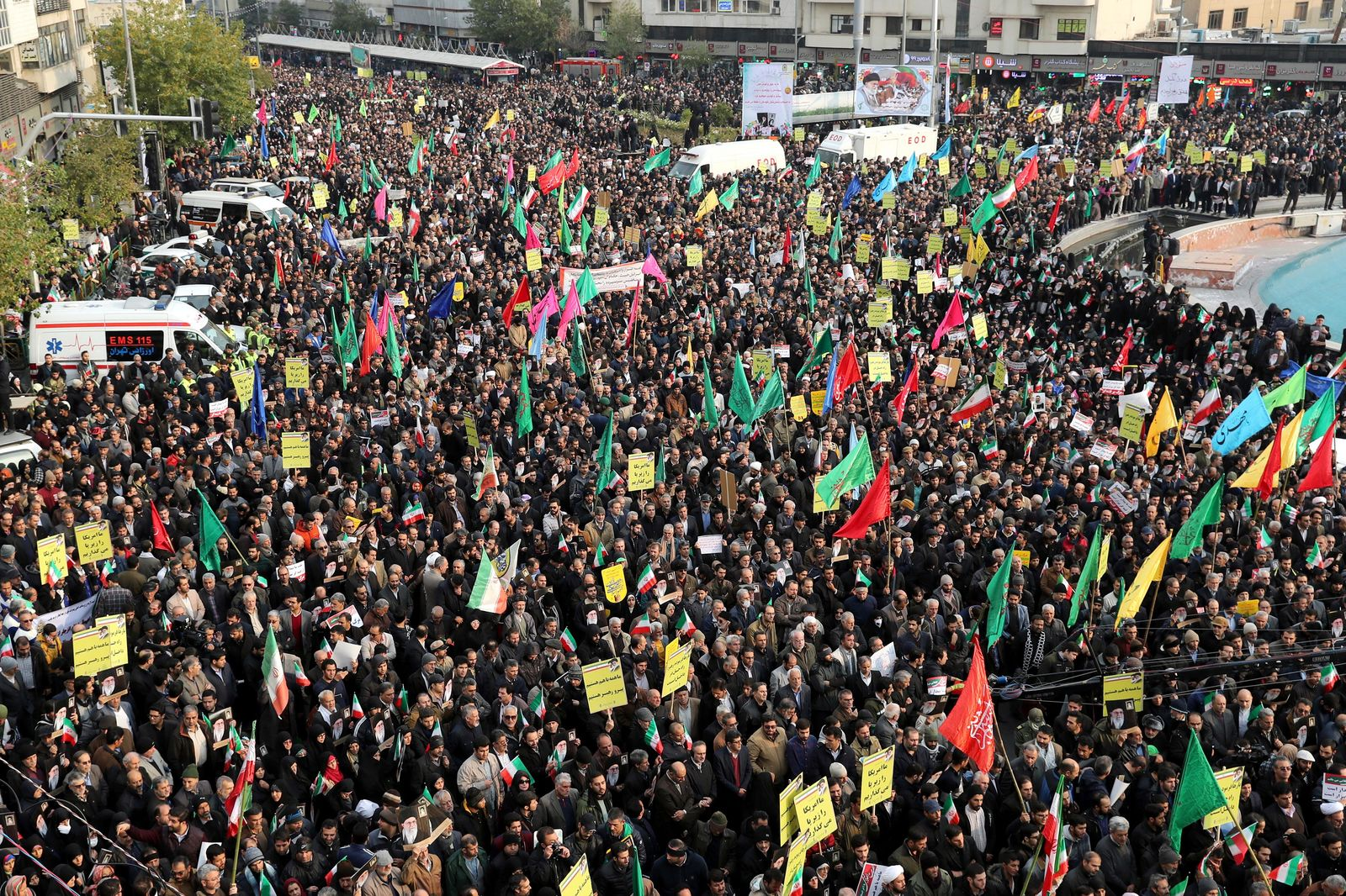 Demonstrators attend a pro-government rally organized by authorities in Iran denouncing last week's violent protests over a fuel price hike, in Tehran, Iran, Monday, Nov. 25, 2019. (AP Photo/Ebrahim Noroozi)
