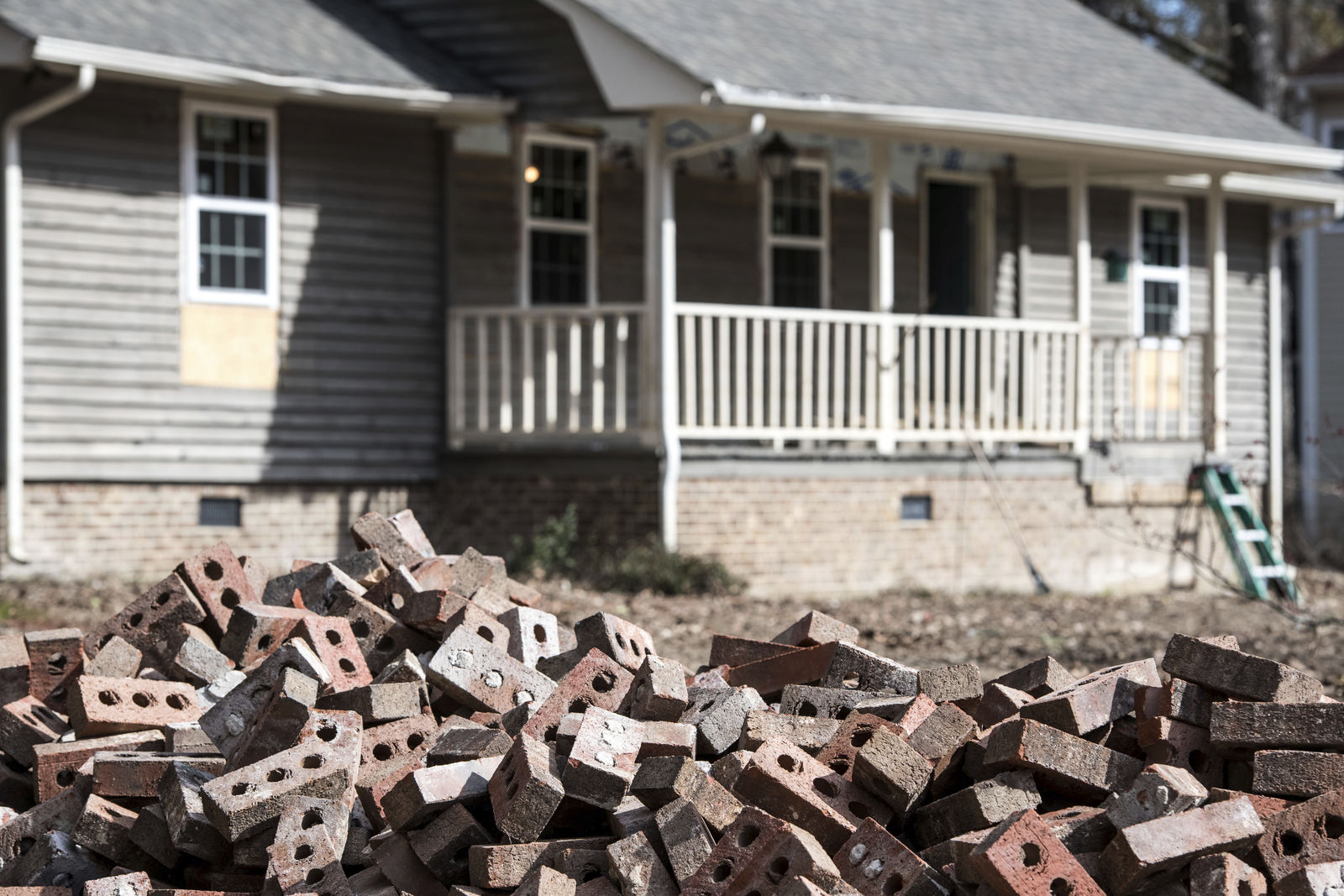 A pile of bricks sits in front of a home scheduled to be raised after being damaged by flooding from Hurricane Florence near the Crabtree Swamp, Friday, Feb. 1, 2019, in Conway, S.C.{ } (AP Photo/Sean Rayford)