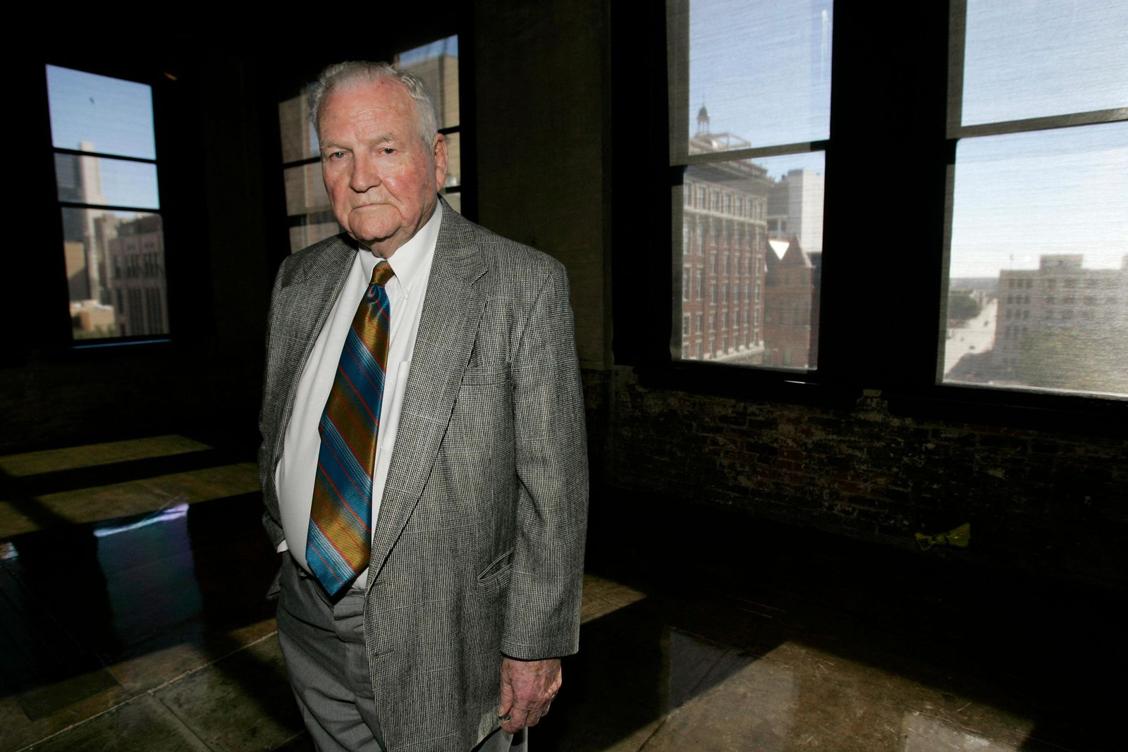 FILE - In this Nov. 19, 2008 file photo, retired Dallas Police Department Detective Jim Leavelle poses in the former book depository building, now known as The Sixth Floor Museum at Dealey Plaza, from which Lee Harvey Oswald fired the fatal shots killing President John F. Kennedy, in Dallas.{ } (AP Photo/Tony Gutierrez)