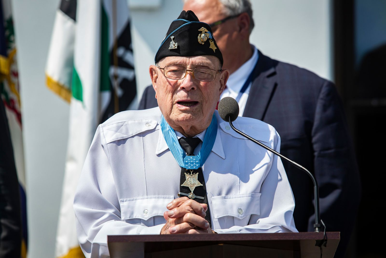 "U.S. Marine Corps Chief Warrant Officer 4 Hershel ""Woody"" Williams speaks during a hangar dedication ceremony at the Capital Jet Center in Charleston, West Virginia, July 26, 2019. Williams is the last surviving Marine Corps, World War II Medal of Honor recipient. (U.S. Marine Corps photo by Staff Sgt. William Holdaway)"