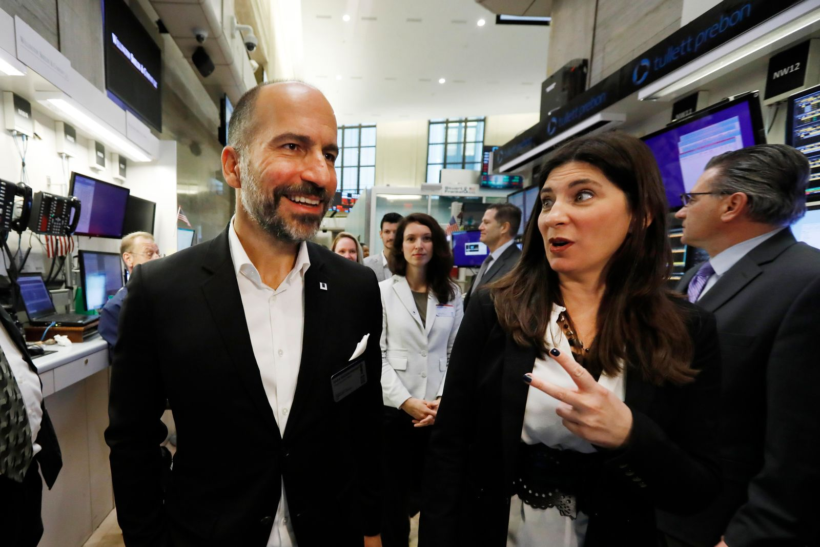 Uber CEO Dara Khosrowshahi, left, walks with Stacy Cunningham, president of the New York Stock Exchange, prior to his company holding its initial public offering, Friday, May 10, 2019. (AP Photo/Richard Drew)