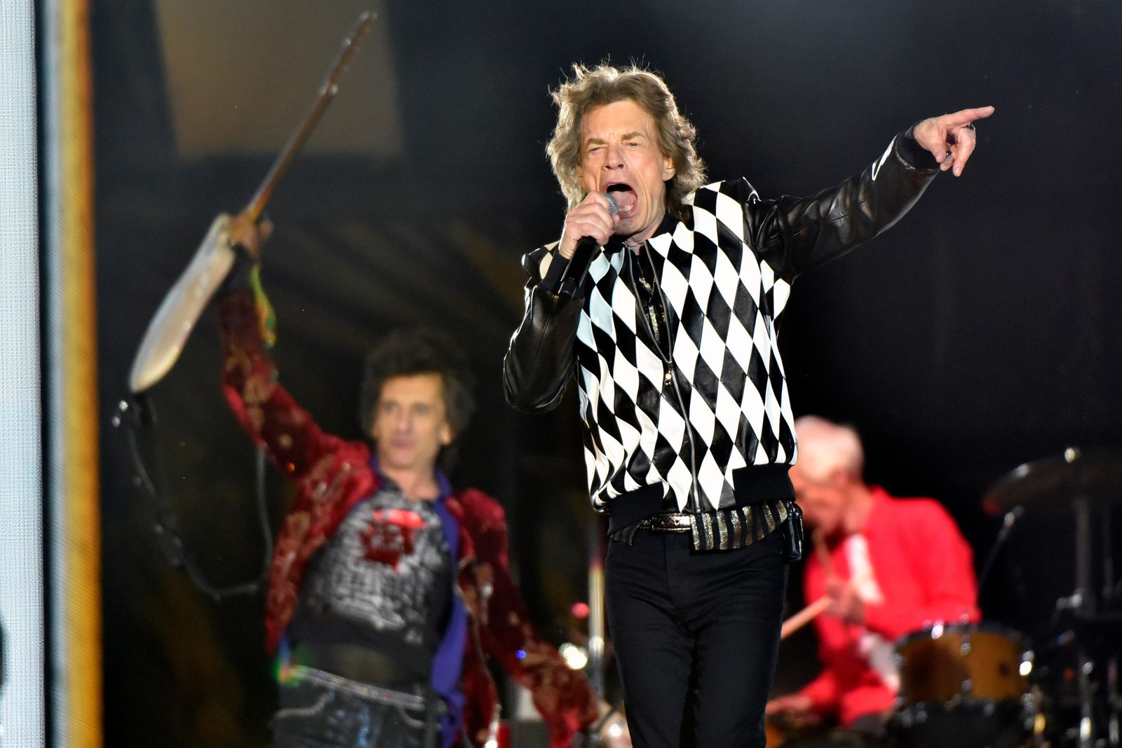 "Ron Wood, left, and Mick Jagger, of the Rolling Stones perform during the ""No Filter"" tour at Soldier Field on Friday, June 21, 2019, in Chicago. (Photo by Rob Grabowski/Invision/AP)"