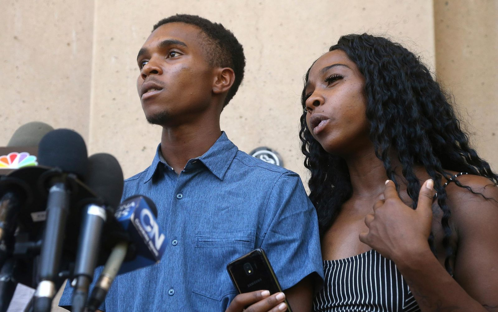 Iesha Harper, right, answers a question during a news conference as she is joined by her fiancee Dravon Ames, left, at Phoenix City Hall, Monday, June 17, 2019, in Phoenix..(AP Photo/Ross D. Franklin)