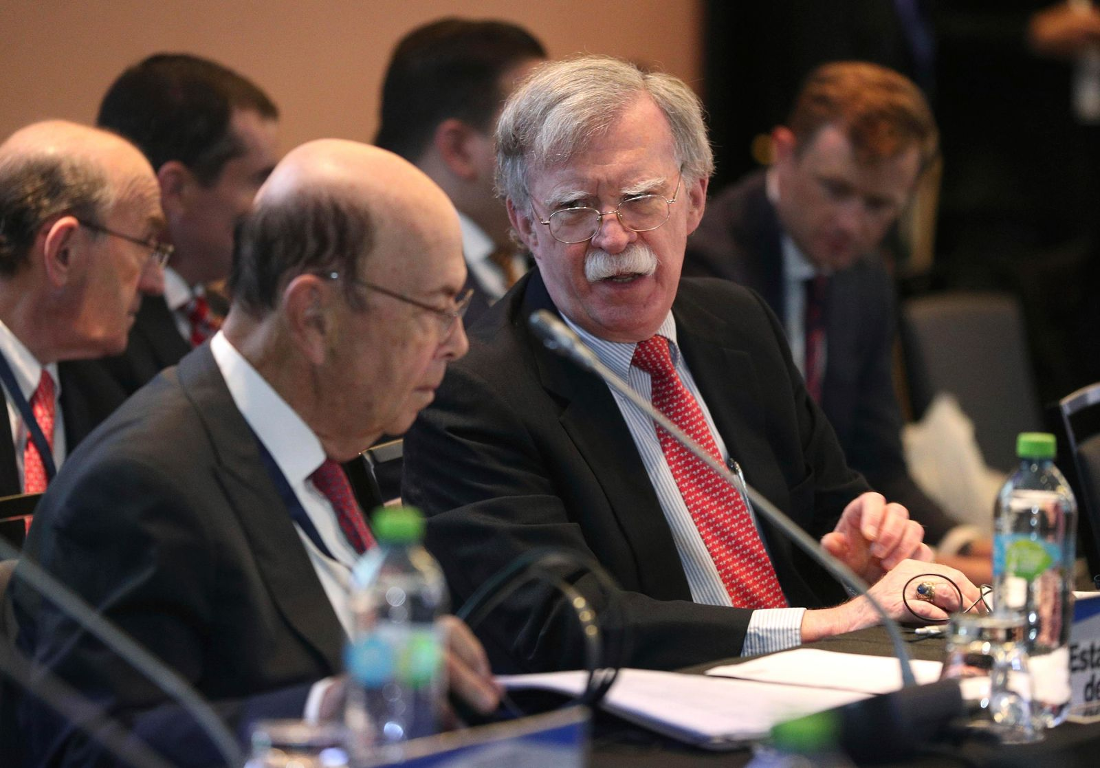 U.S. National security adviser John Bolton, right, speaks with U.S. Commerce Secretary Wilbur Ross during a conference of more than 50 nations that largely support Venezuelan opposition leader Juan Guaido in Lima, Peru, Tuesday, Aug. 6, 2019. The Trump administration froze all Venezuelan government assets in a dramatic escalation of tensions with Nicolas Maduro that places his socialist administration alongside a short list of adversaries from Cuba, North Korea, Syria and Iran that have been targeted by such aggressive U.S. actions. (AP Photo/Martin Mejia)