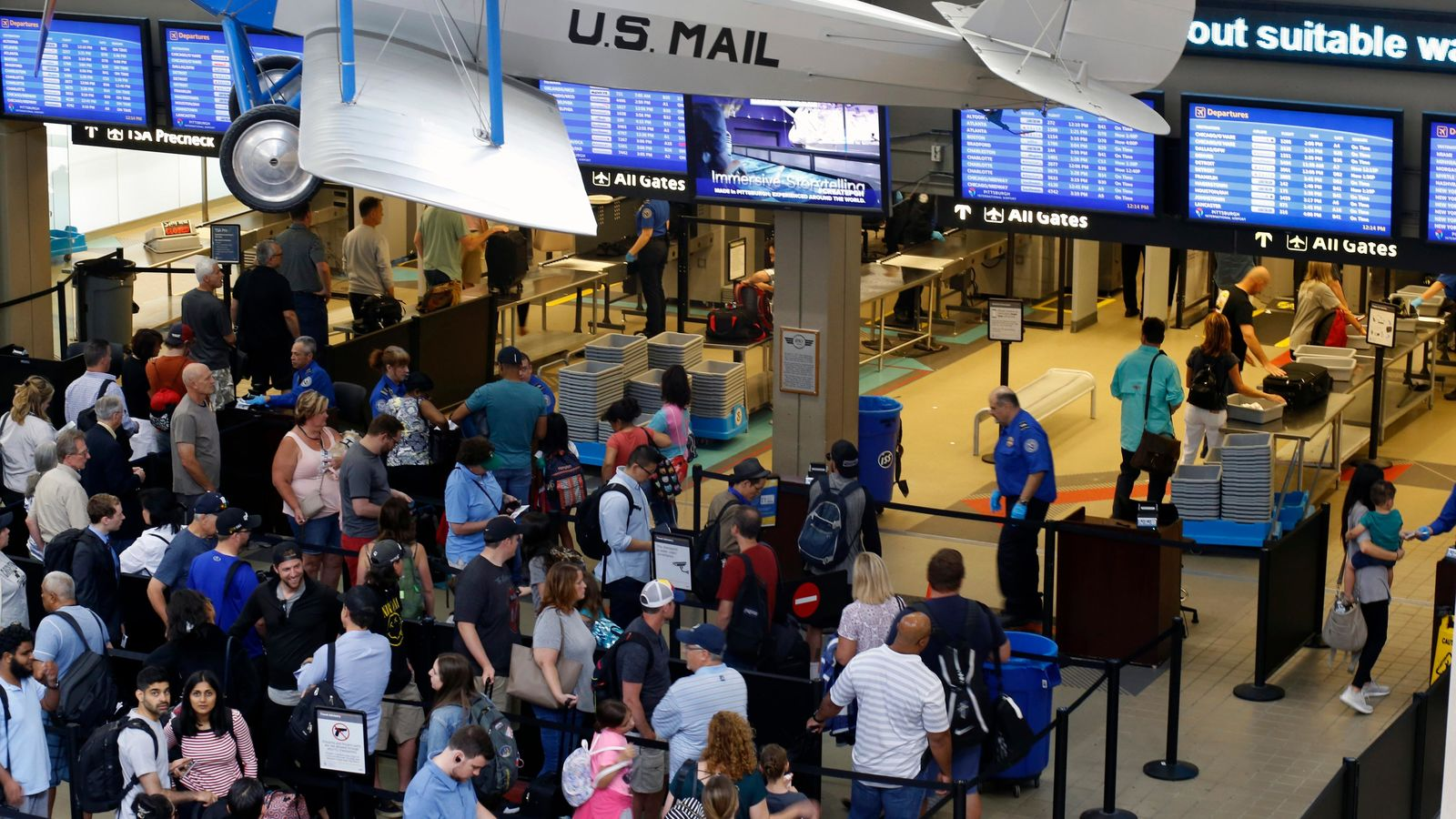 FILE - This June 9, 2019, file photo shows the TSA security checkpoint in Pittsburgh International's Landside terminal in Imperial, Pa. . (AP Photo/Gene J. Puskar, File)