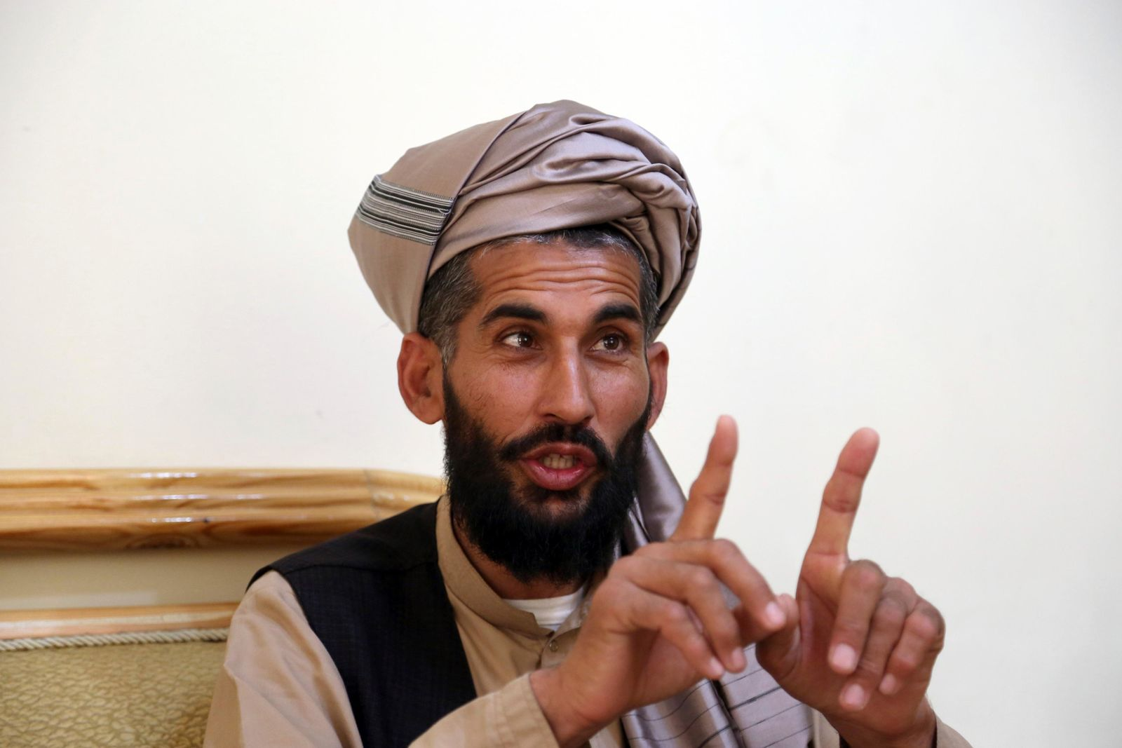 In this Tuesday, April 23, 2019, photo, Masih Rahman speaks during an interview with the Associated Press in Kabul, Afghanistan.{ } (AP Photo/Rahmat Gul)