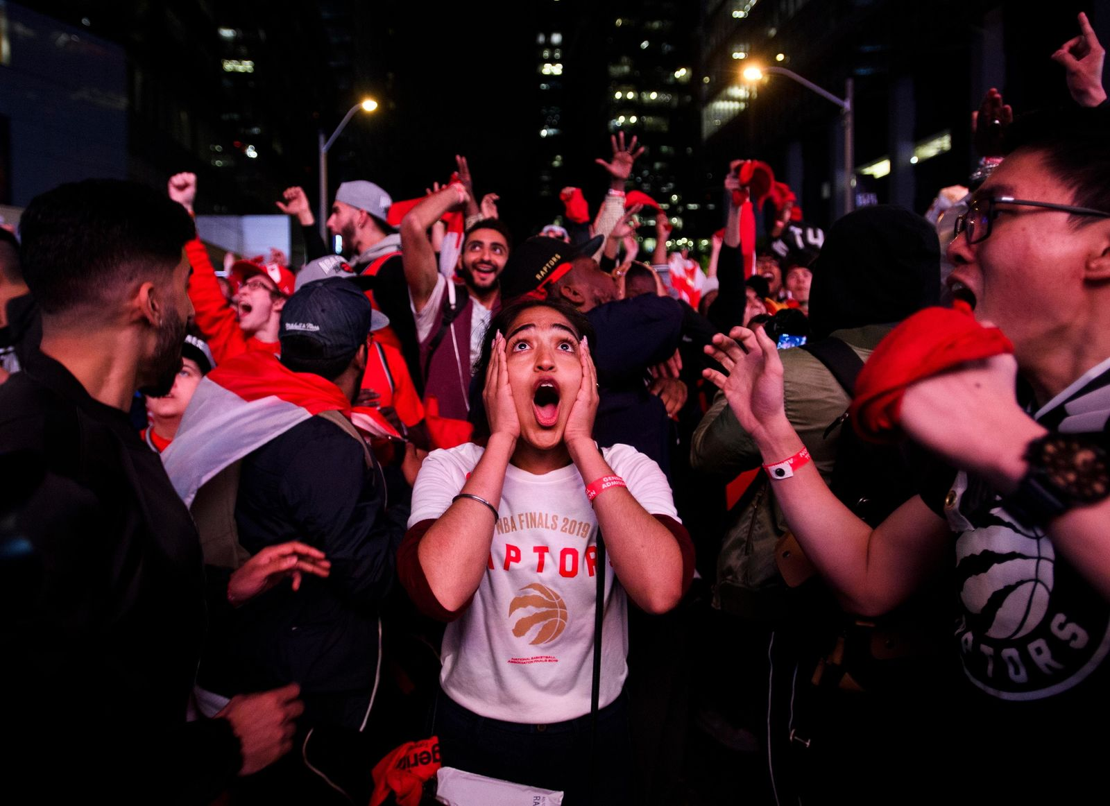 Fan reacts in Jurassic Park outside Scotiabank Arena in Toronto as the Toronto Raptors defeated the Golden State Warriors 114-110 in Game 6 of basketball's NBA Finals, Thursday, June 13, 2019, in Oakland, Calif. (Nathan Denette/The Canadian Press via AP)