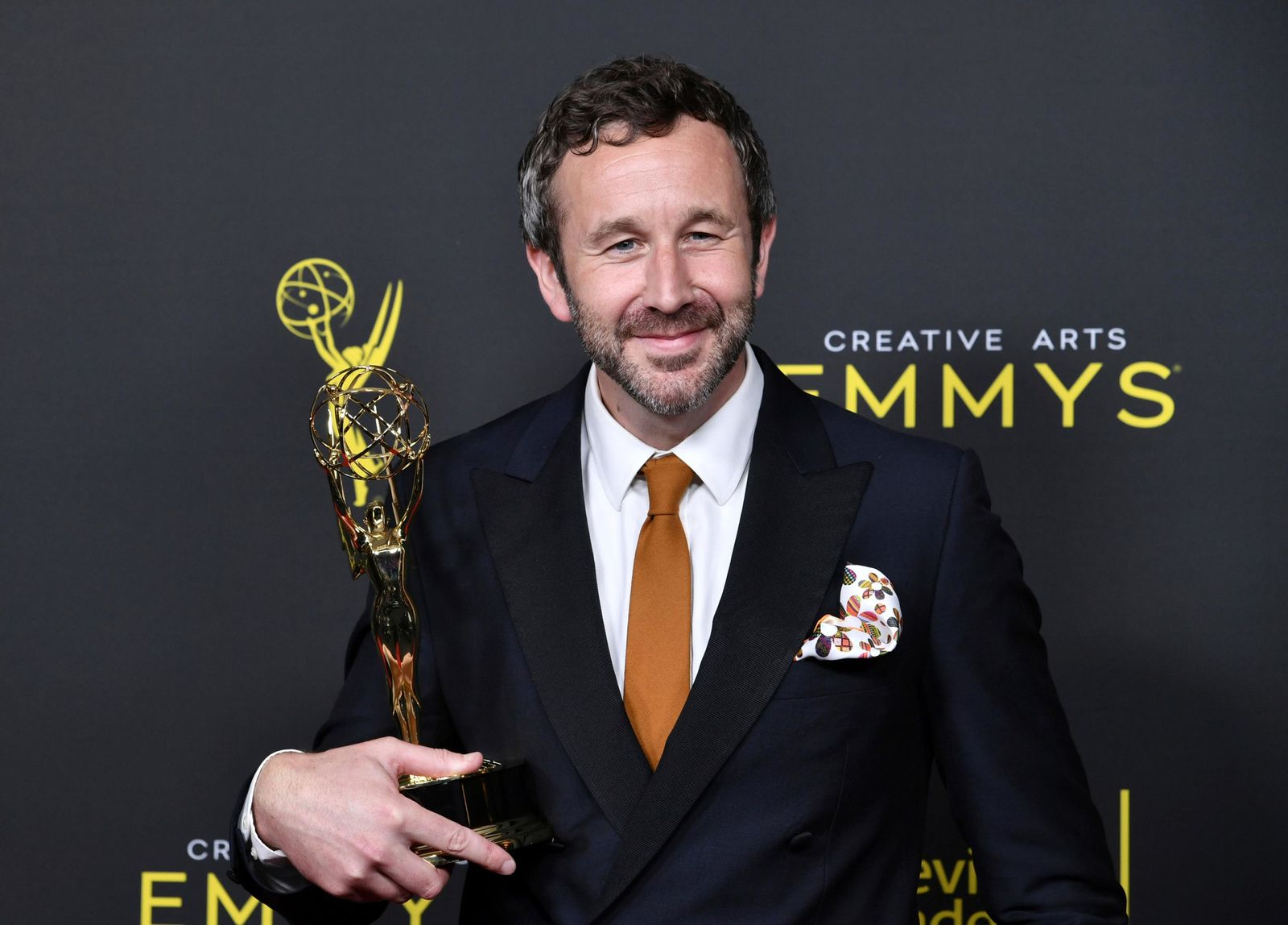 "CORRECTS THE DATE TO SUNDAY, SEPT. 15 -  Chris O'Dowd poses in the press room with the award for outstanding actor in a short form comedy or drama series for ""State Of The Union"" on night two of the Creative Arts Emmy Awards on Sunday, Sept. 15, 2019, at the Microsoft Theater in Los Angeles. (Photo by Richard Shotwell/Invision/AP)"