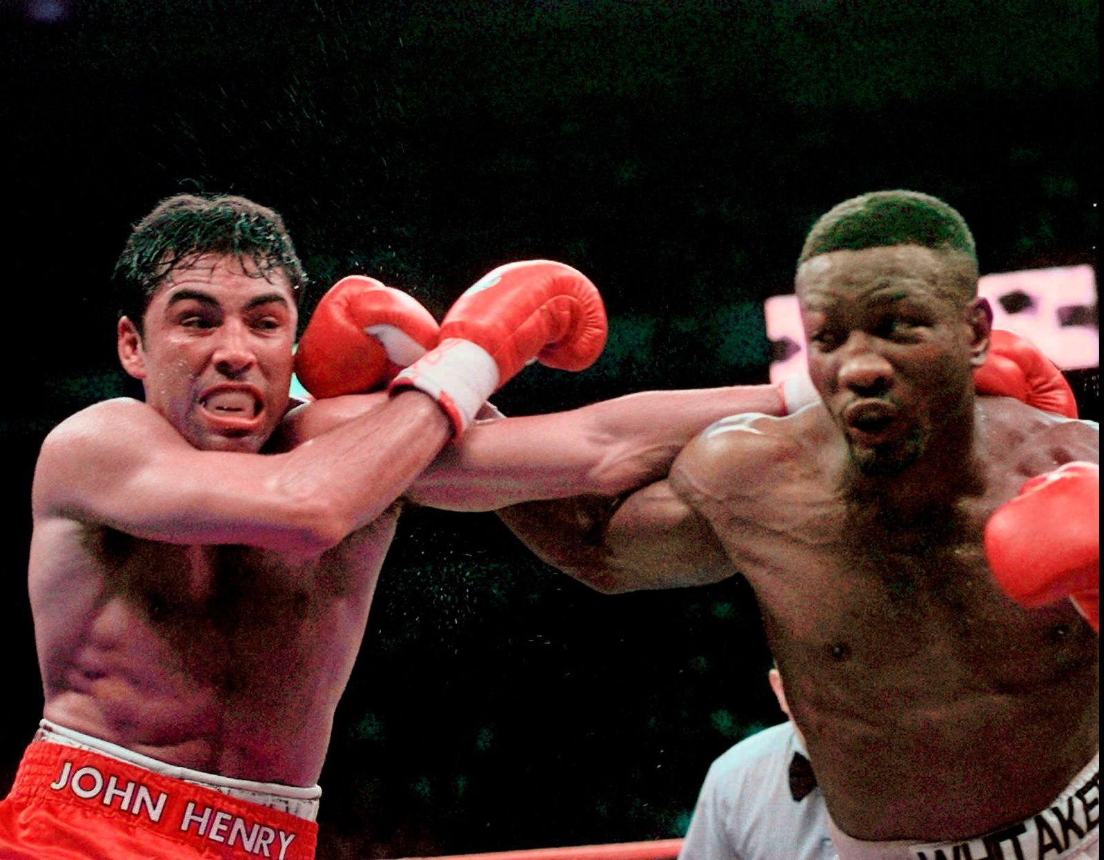 FILE - In this April 12, 1997, file photo, Oscar De La Hoya and Pernell Whitaker, right, exchange punches during their WBC Welterweight Championship fight at Thomas & Mack Center in Las Vegas.{ } (AP Photo/Bob Galbraith, File)