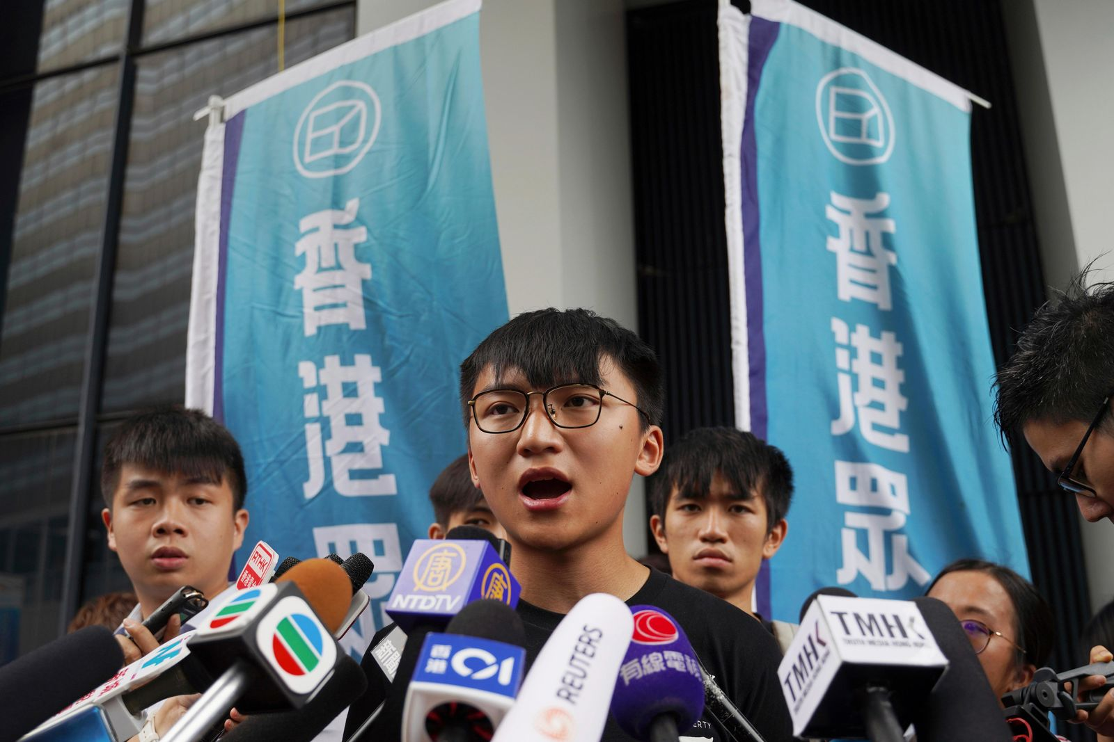 Issac Cheng, vice-chairperson of Demosisto, speaks to reporters in Hong Kong Friday, Aug. 30, 2019.{ } (AP Photo/Vincent Yu)