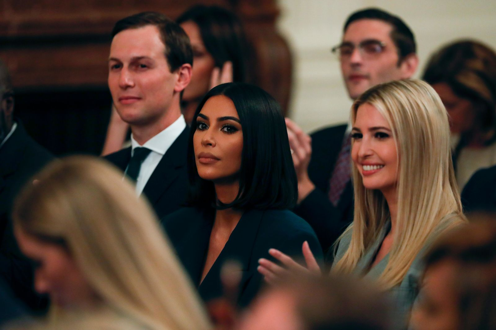 White House senior adviser Jared Kushner and Ivanka Trump, right, sit with Kim Kardashian West, who is among the celebrities who have advocated for criminal justice reform, as they listen to President Donald Trump speak about second chance hiring in the East Room of the White House, Thursday June 13, 2019, in Washington. (AP Photo/Jacquelyn Martin)