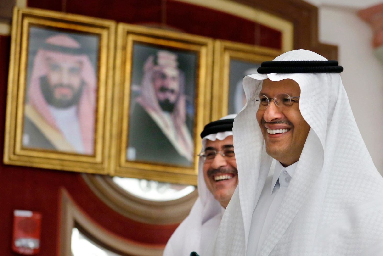 Energy Minister Prince Abdulaziz bin Salman, right, and Aramco CEO Amin Al-Nasser smile as they leave a press conference in Jiddah, Saudi Arabia, Tuesday, Sept. 17, 2019. (AP Photo/Amr Nabil)