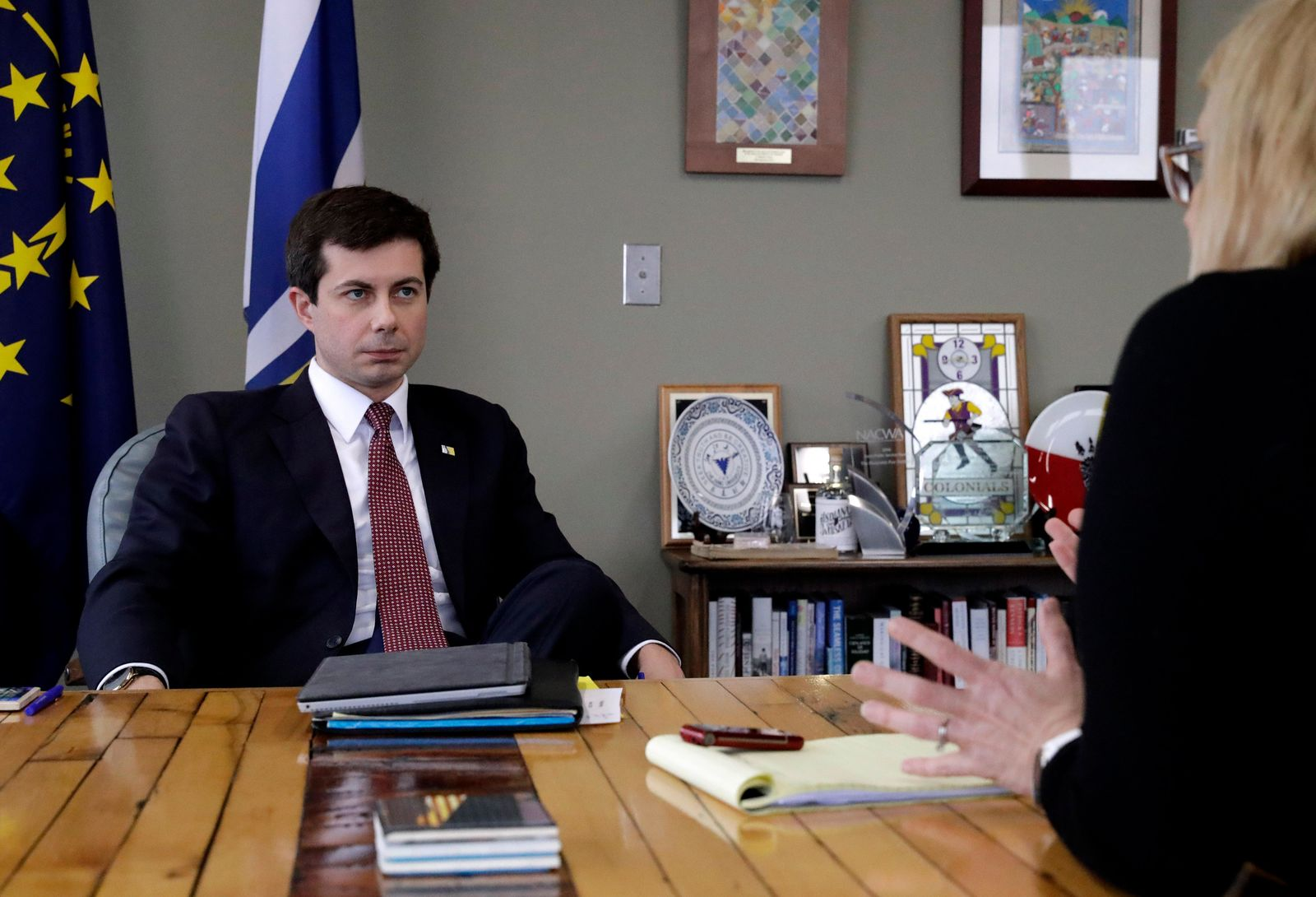 Mayor Pete Buttigieg listens to an AP reporter at his office in South Bend, Ind., Thursday, Jan. 10, 2019. (AP Photo/Nam Y. Huh)