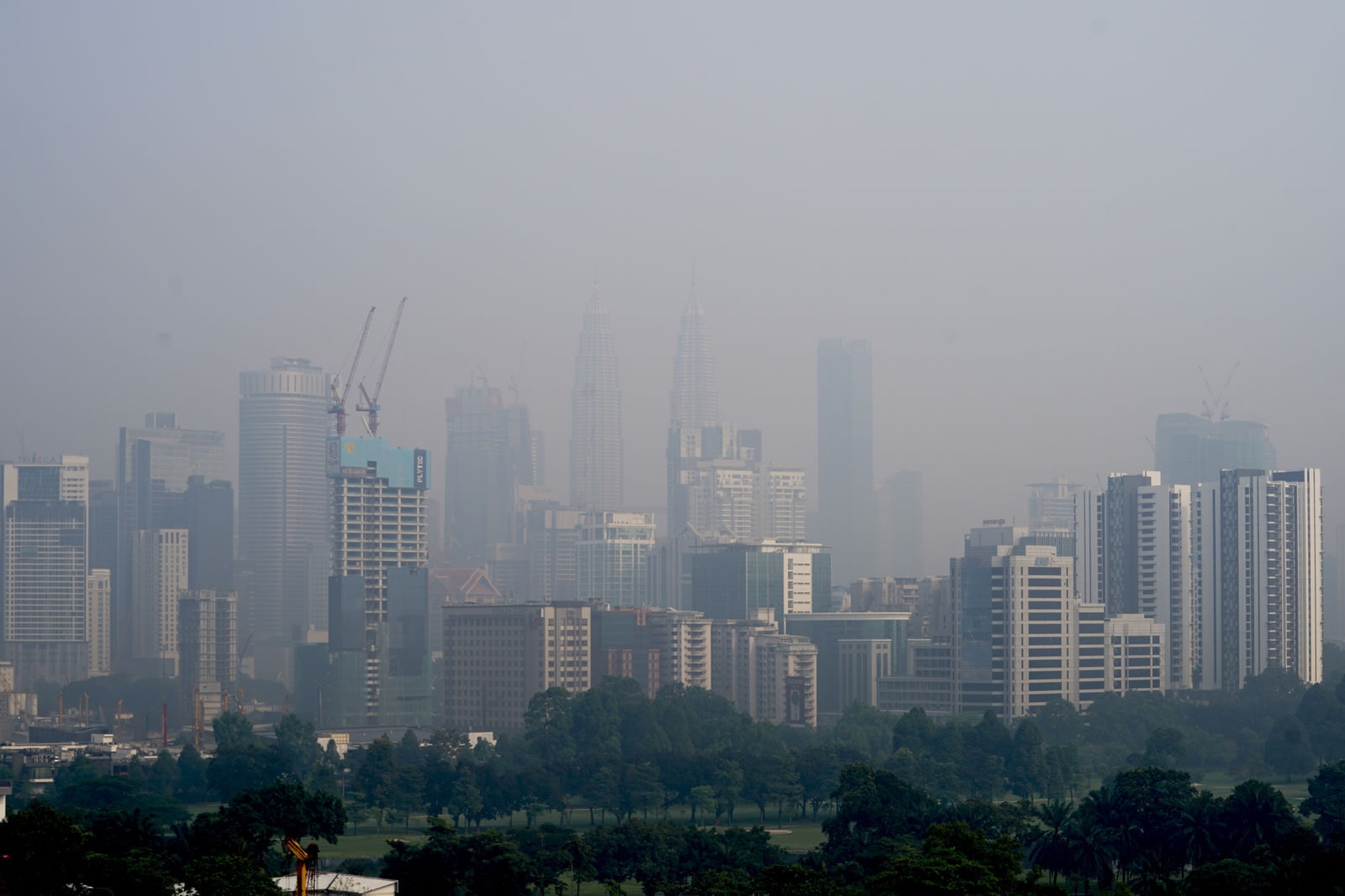Kuala Lumpur city stands shrouded with haze in Kuala Lumpur, Malaysia, Tuesday, Sept. 17, 2019. More than 100 schools were closed Tuesday after the air quality in the area continued to trend at very unhealthy levels. (AP Photo/Vincent Thian)