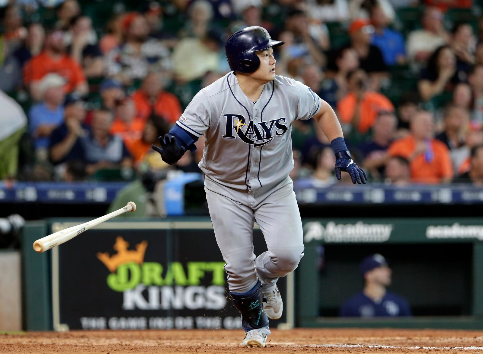 Tampa Bay Rays' Ji-Man Choi flips his bat as heads to first base on his two-un RBI-double during the seventh inning of a baseball game against the Houston Astros, Thursday, Aug. 29, 2019, in Houston. (AP Photo/Michael Wyke)