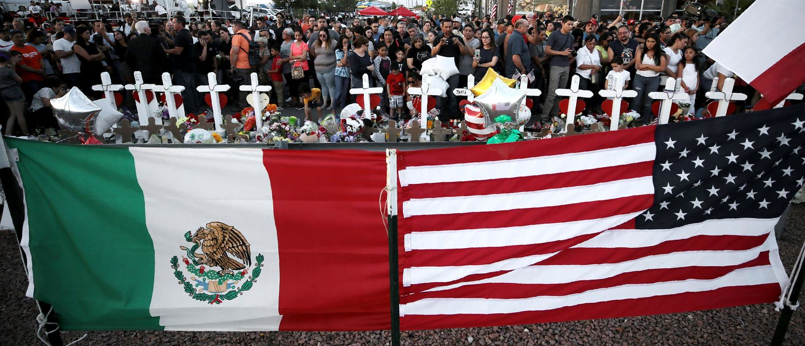 People show up in masses Monday, Aug. 5, 2019, to pay their respects to those who lost their lives in Saturday's attack in El Paso, Texas. (Mark Lambie/The El Paso Times via AP)