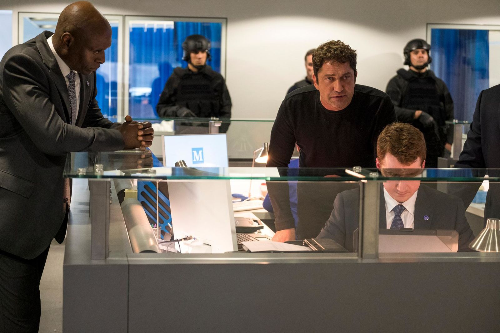 "This image released by Lionsgate shows Lance Reddick, left, and Gerard Butler in ""Angel Has Fallen,"" directed by Ric Roman Waugh. Hollywood's summer season came to a close Sunday, Sept. 1, 2019, with a whimper, as Butler's action thriller topped the box office for the second weekend and ticket sales on the season finished 2% behind last year. The Labor Day weekend is traditionally a quiet one for movie theaters. No major releases entered the marketplace, allowing the third installment in the ""Fallen"" series to stay on top with an estimated $11.6 million.  (Jack English/Lionsgate via AP)"