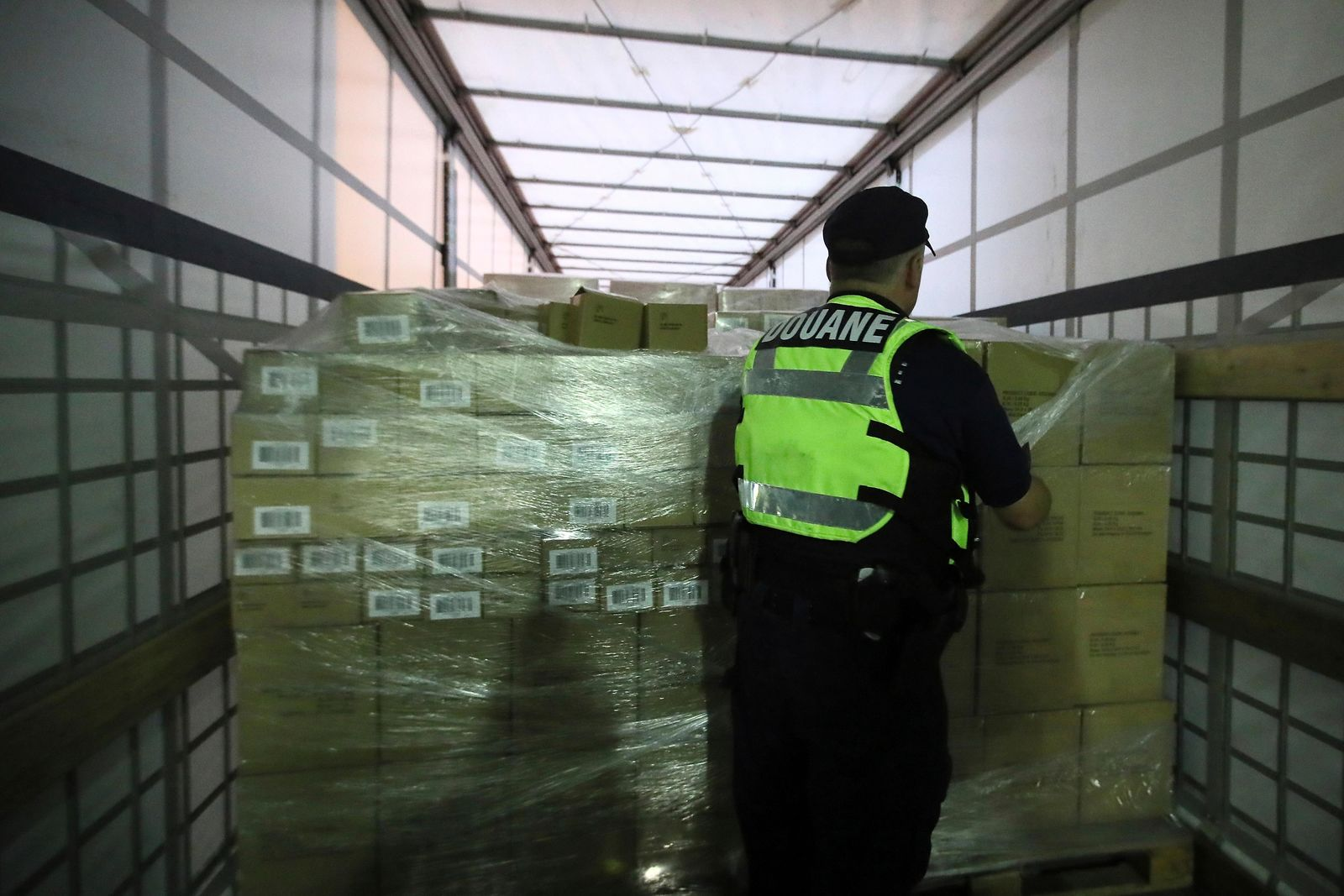 A French custom officer checks a truck coming from Britain's port of Portsmouth at the transit zone at the port of Ouistreham, Normandy, Thursday, Sept.12, 2019. France has trained 600 new customs officers and built extra parking lots arounds its ports to hold vehicles that will have to go through extra checks if there is no agreement ahead of Britain's exit from the EU, currently scheduled on Oct. 31. (AP Photo/David Vincent)