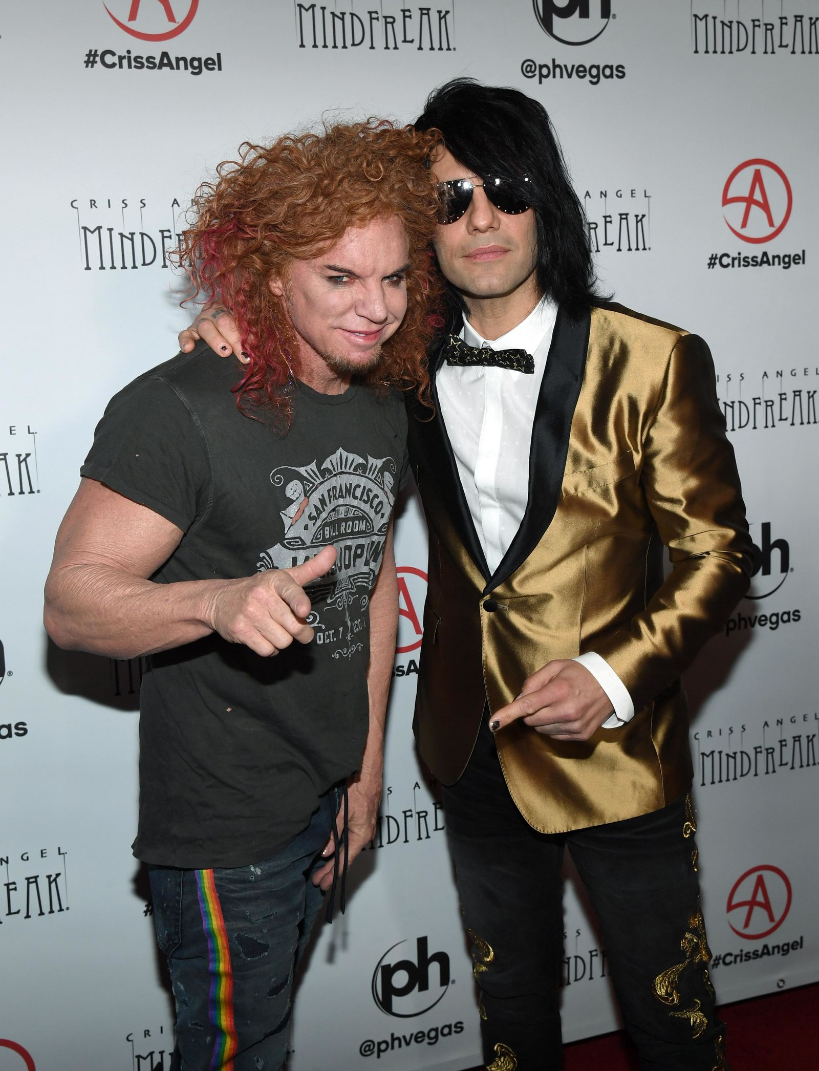 "LAS VEGAS, NEVADA - JANUARY 19:  Comedian Carrot Top (L) and illusionist Criss Angel attend the grand opening of ""Criss Angel MINDFREAK"" at Planet Hollywood Resort & Casino on January 19, 2019 in Las Vegas, Nevada.  (Photo by Ethan Miller/Getty Images for Planet Hollywood Resort & Casino)"