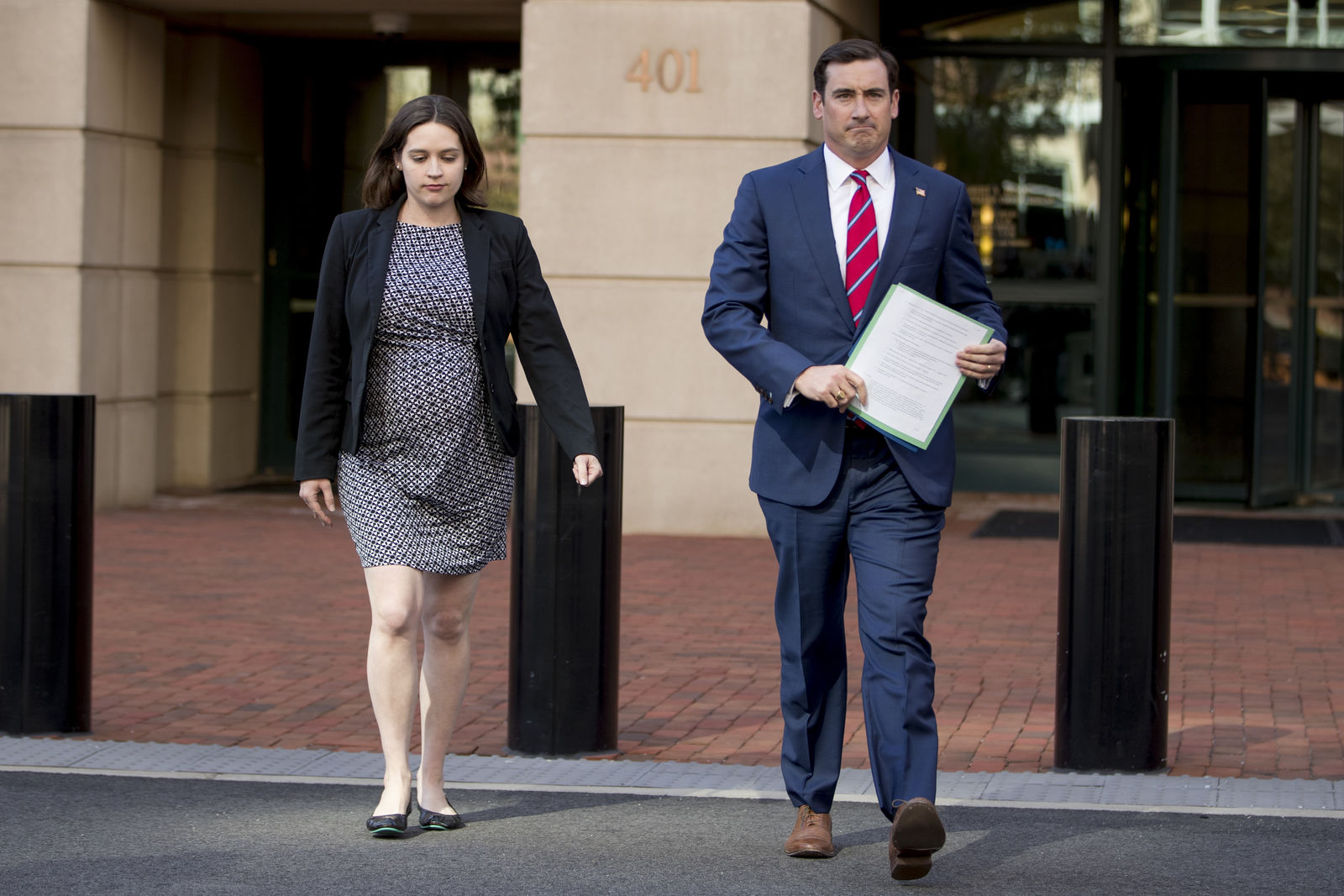 Attorney General for the Eastern District of Virginia G. Zachary Terwilliger, right, accompanied by Assistant United States Attorney Danya Atiyeh, left, arrives to announce the arrest of Henry Kyle Frese, a Defense Intelligence Agency official in Alexandria, Va., Wednesday, Oct. 9, 2019. (AP Photo/Andrew Harnik)