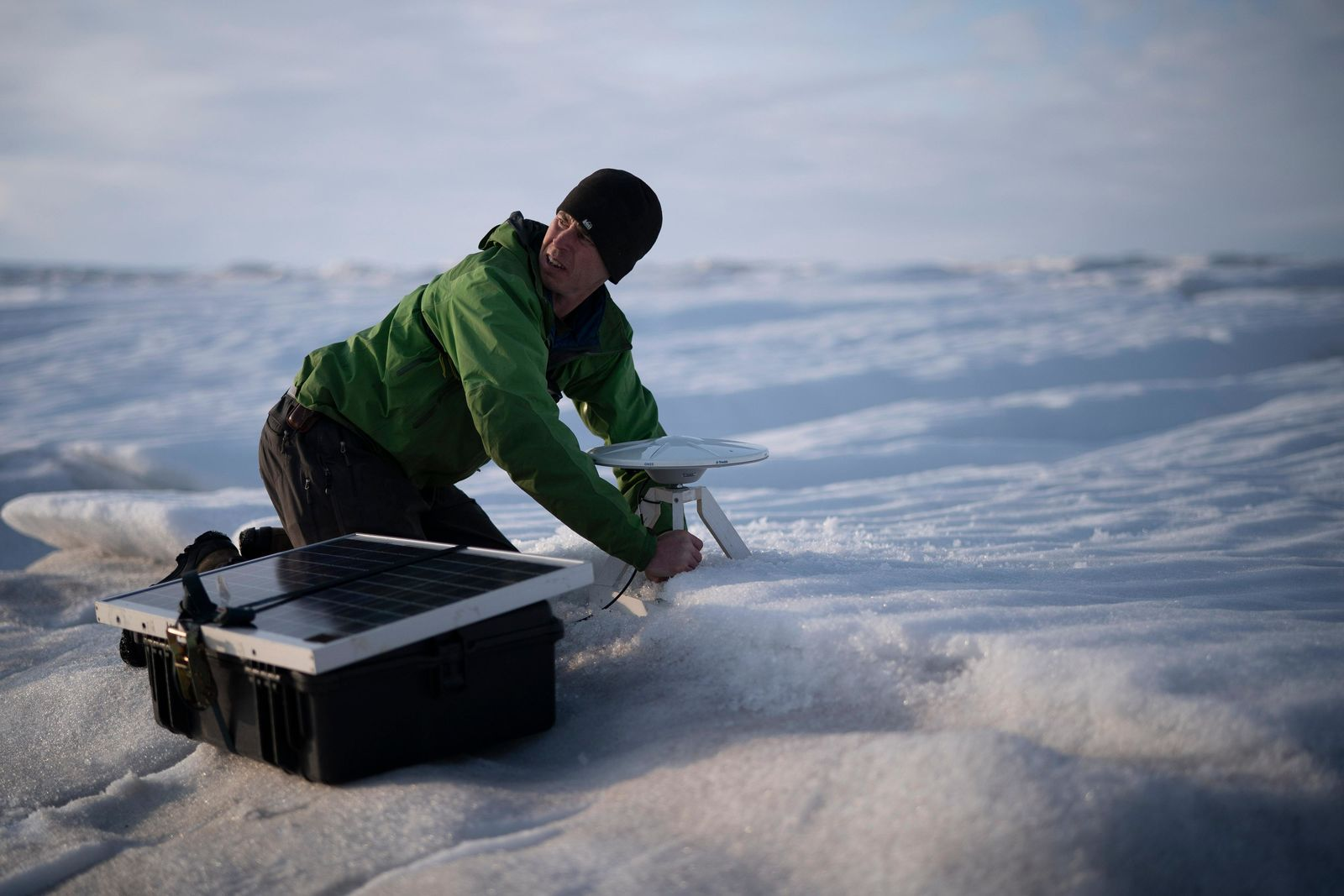 In this Aug. 16, 2019, photo, Brian Rougeux, NYU Field Safety Officer, installs a GPS antenna at the Helheim glacier, in Greenland. An NYU team is tracking what's happening in Greenland from both above and below. . (AP Photo/Felipe Dana)