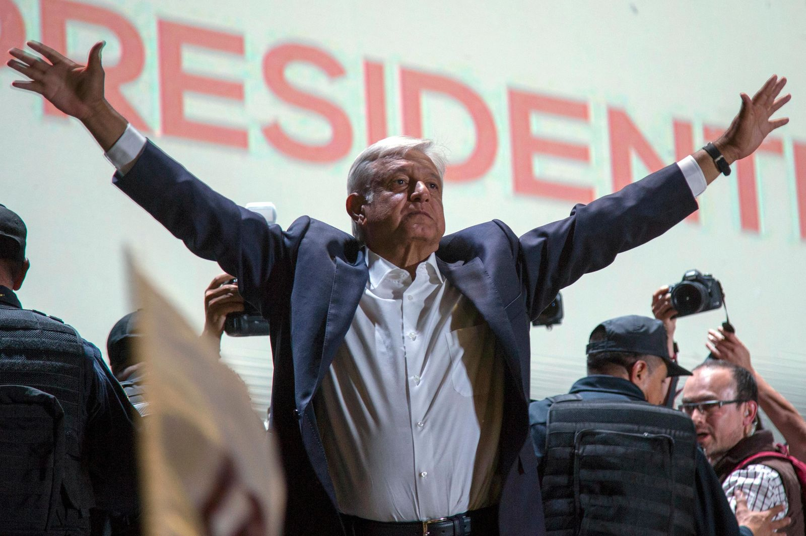 Presidential candidate Andres Manuel Lopez Obrador acknowledges his supporters as he arrives to Mexico City's main square, the Zocalo, Sunday, July 1, 2018. (AP Photo/Anthony Vazquez)