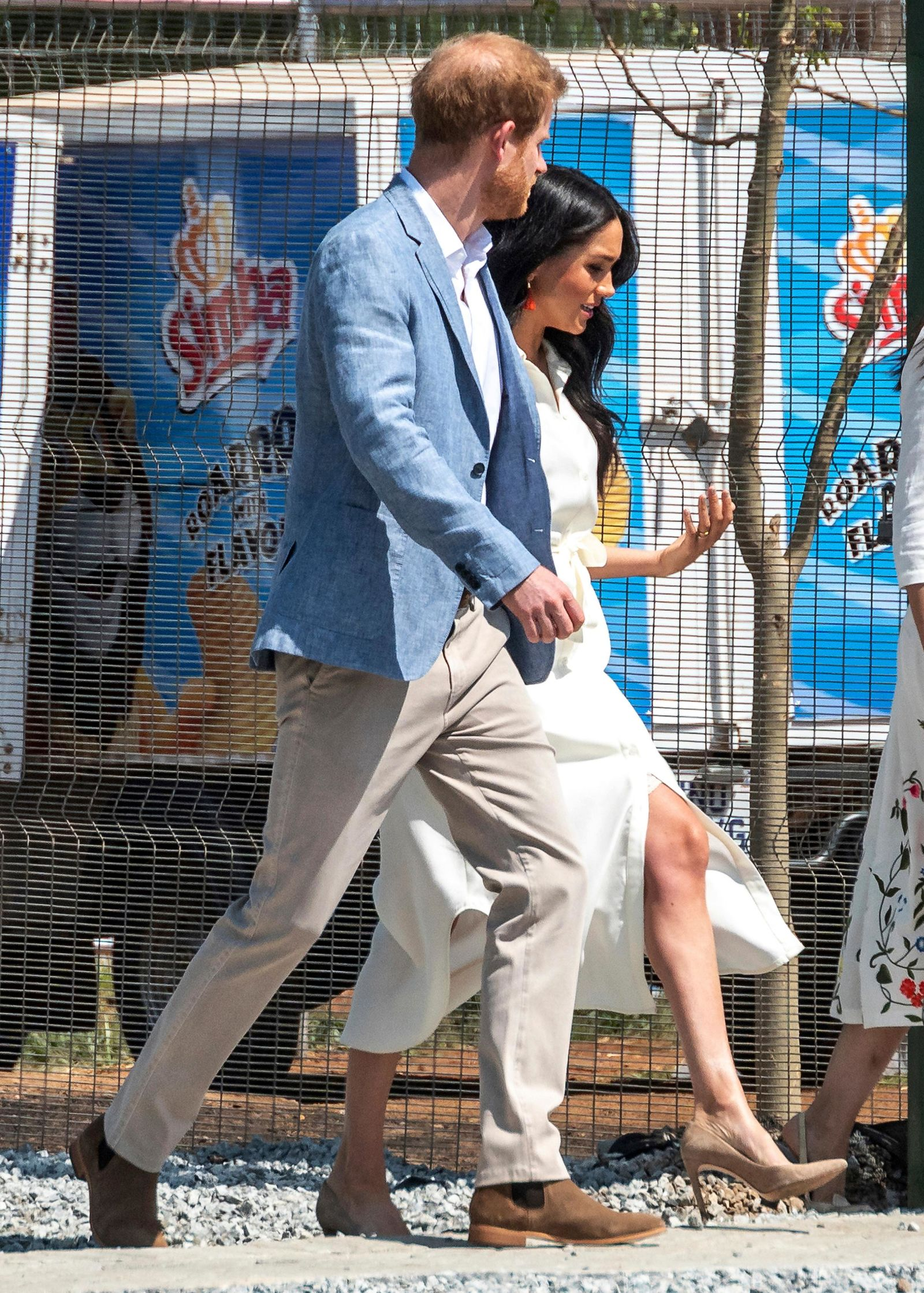 Britain's Prince Harry and Meghan, Duchess of Sussex visit a Youth Employment Services Hub in Makhulong, Tembisa, a township near Johannesburg, South Africa, Wednesday Oct. 2, 2019. (AP Photo/Christiaan Kotze)