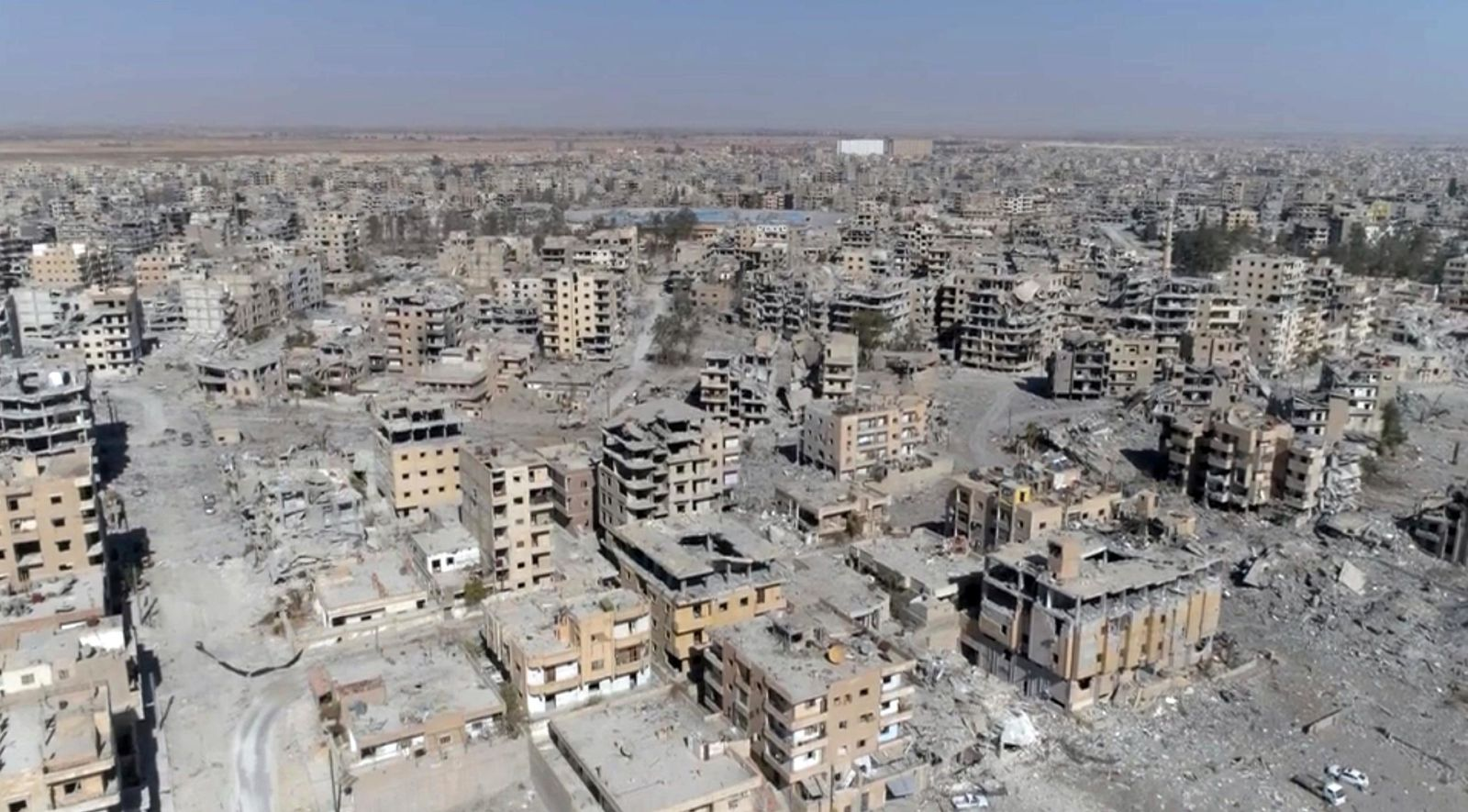 This Thursday, Oct. 19, 2017 frame grab made from drone video shows damaged buildings in Raqqa, Syria, two days after Syrian Democratic Forces said that military operations to oust the Islamic State group have ended and that their fighters have taken full control of the city. (AP Photo/ Gabriel Chaim)