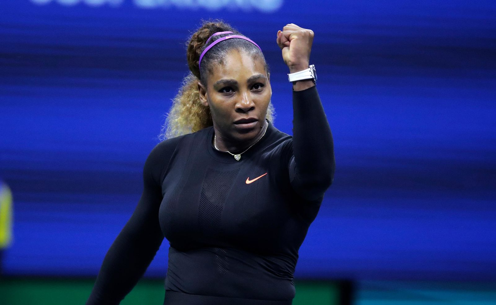Serena Williams, of the United States, raises her fist after defeating Caty McNally, of the United States, during the second round of the U.S. Open tennis tournament in New York, Wednesday, Aug. 28, 2019. (AP Photo/Charles Krupa)