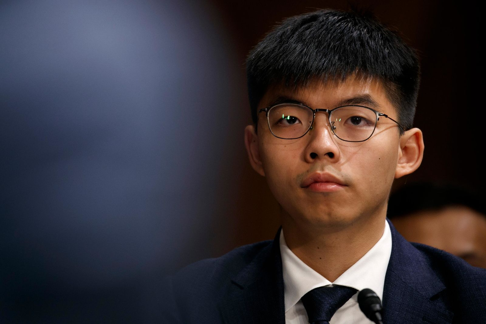 Hong Kong activist Joshua Wong, listens during a congressional hearing on the Hong Kong protests, Tuesday, Sept. 17, 2019, on Capitol Hill in Washington. (AP Photo/Jacquelyn Martin)