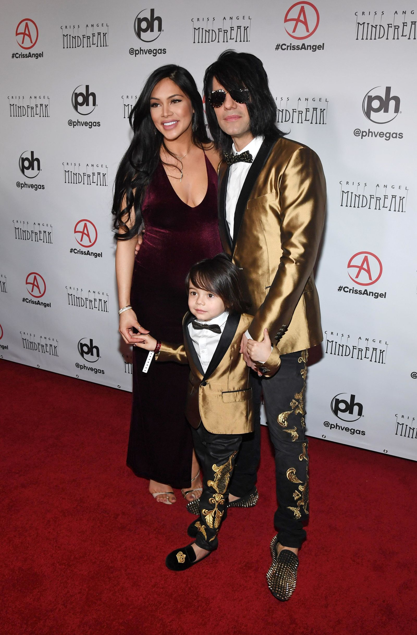 "LAS VEGAS, NEVADA - JANUARY 19:  (L-R) Shaunyl Benson, Johnny Crisstopher Sarantakos and illusionist Criss Angel attend the grand opening of ""Criss Angel MINDFREAK"" at Planet Hollywood Resort & Casino on January 19, 2019 in Las Vegas, Nevada.  (Photo by Ethan Miller/Getty Images for Planet Hollywood Resort & Casino)"