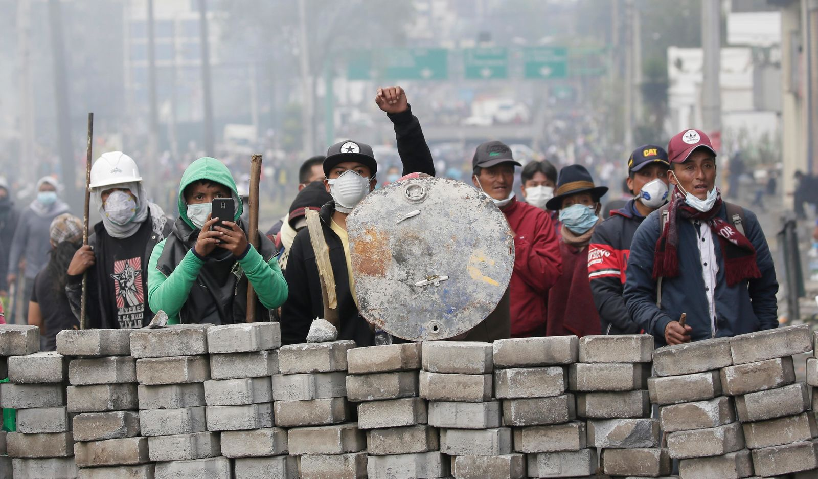 Anti-government demonstrators man a barricade during clashes with the police, near the national assembly building in Quito, Ecuador, Saturday, Oct. 12, 2019. AP Photo/Dolores Ochoa)