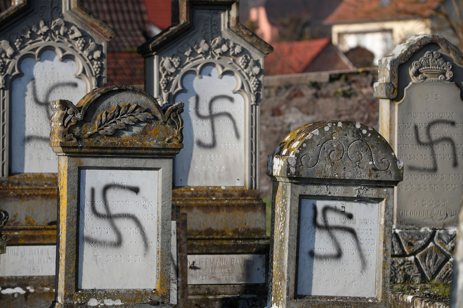 Vandalized tombs are pictured in the Jewish cemetery of Westhoffen, west of (AP Photo/Jean-Francois Badias)
